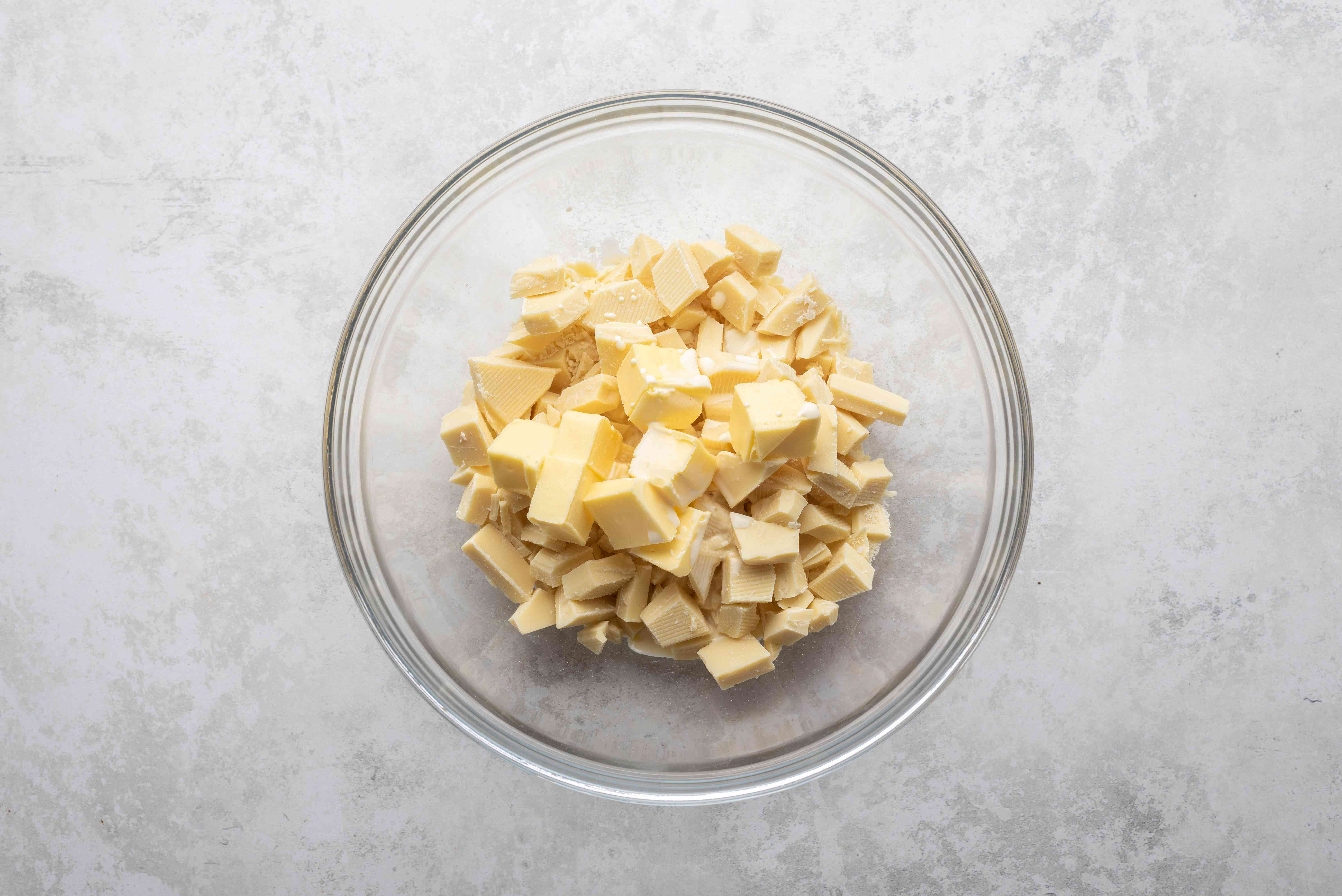 white chocolate, butter, heavy cream, and salt in a bowl