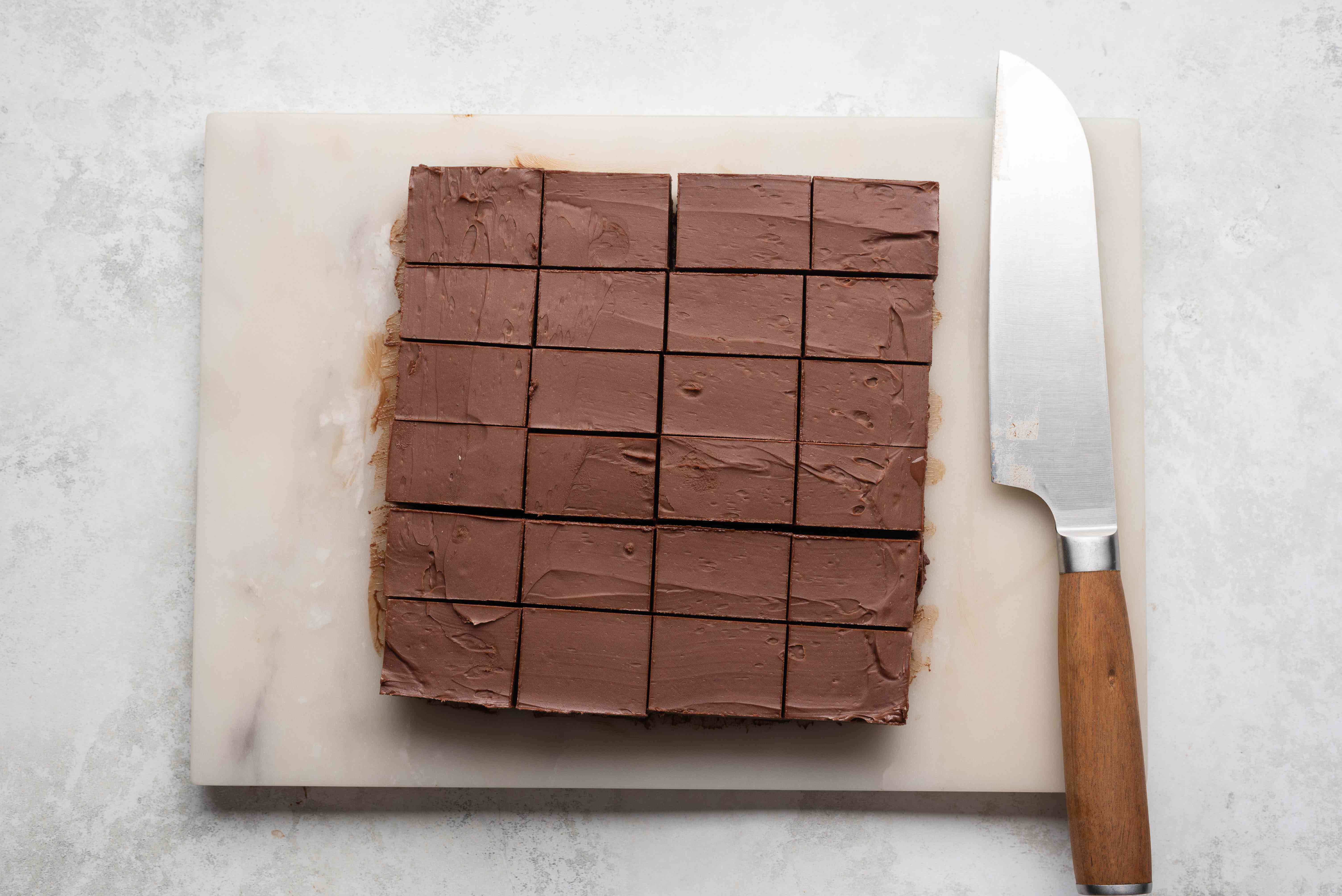 chocolate square cut into pieces on a cutting board