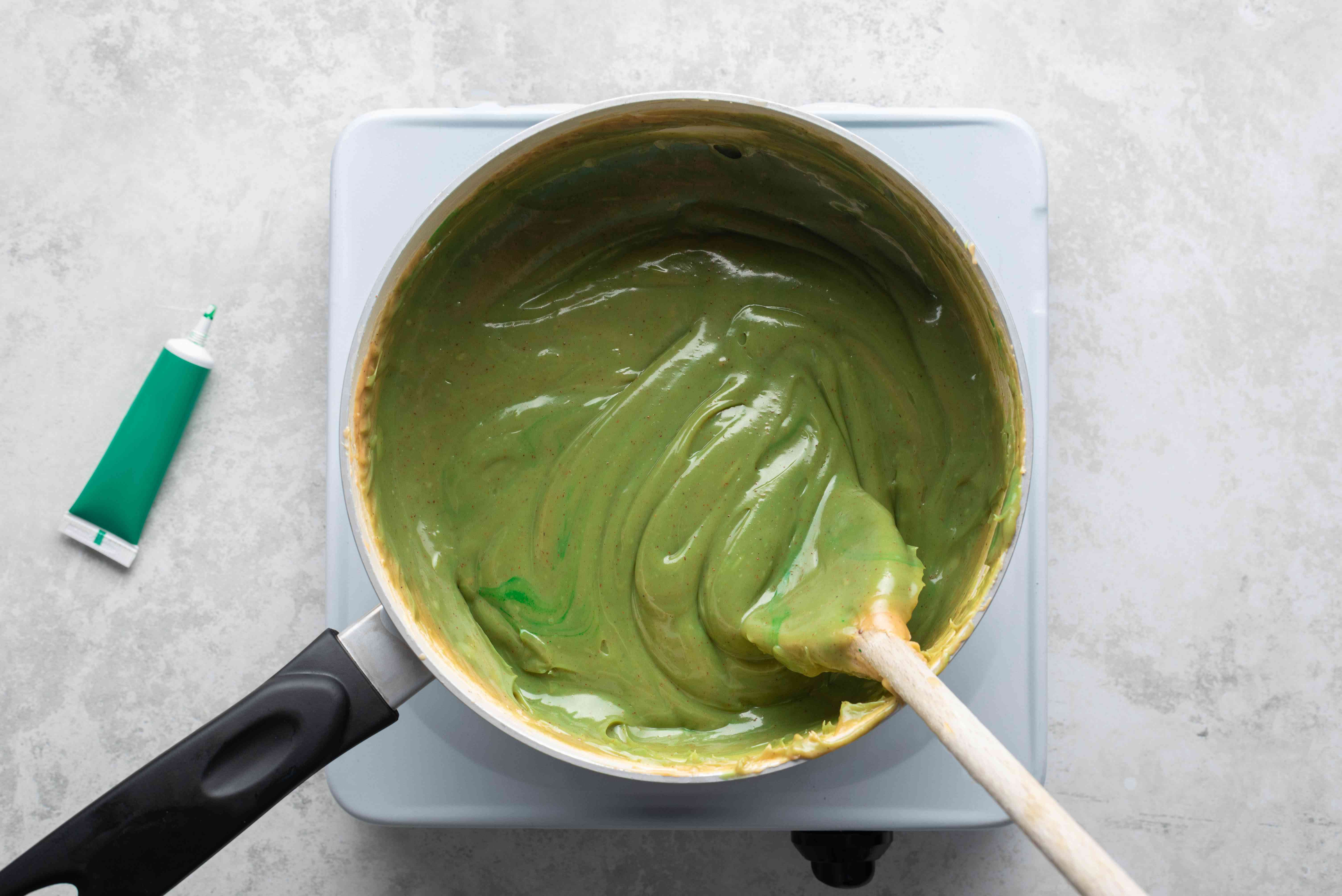 candy with green dye in a saucepan