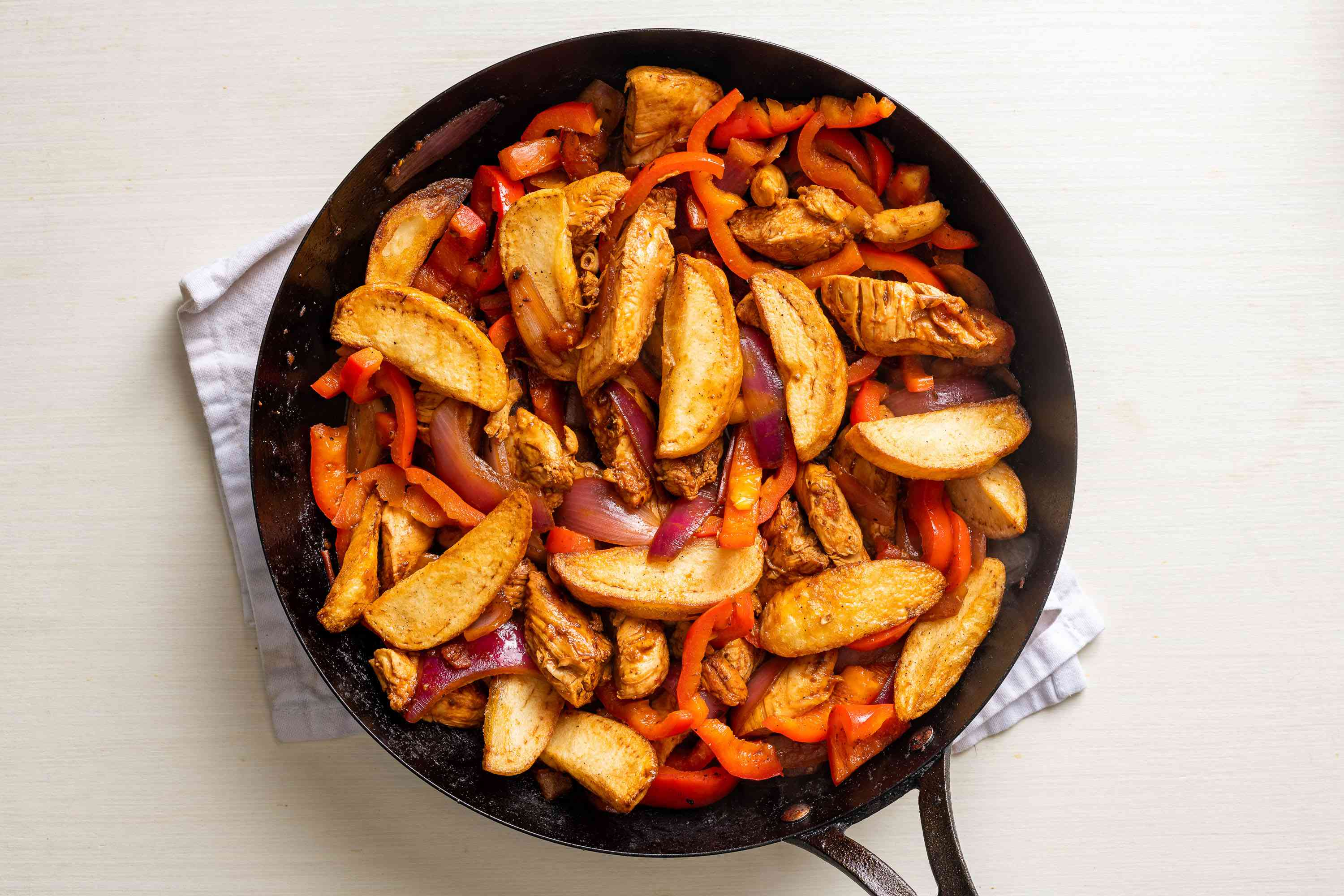 potatoes added to the pan with chicken and vegetables