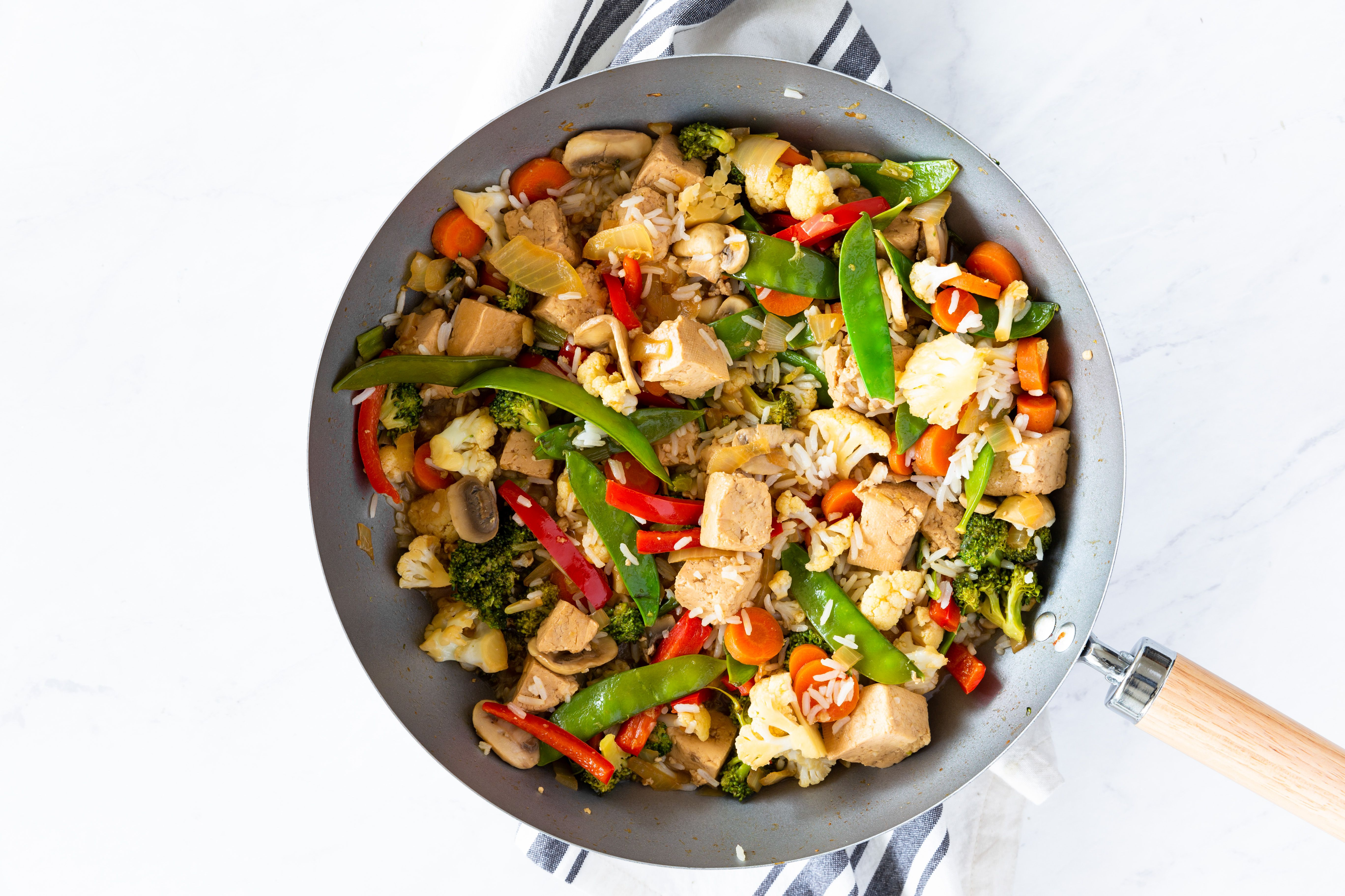 Rice and tofu-veggie stir fry in pan