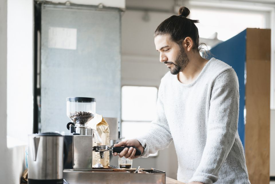 man using espresso machine