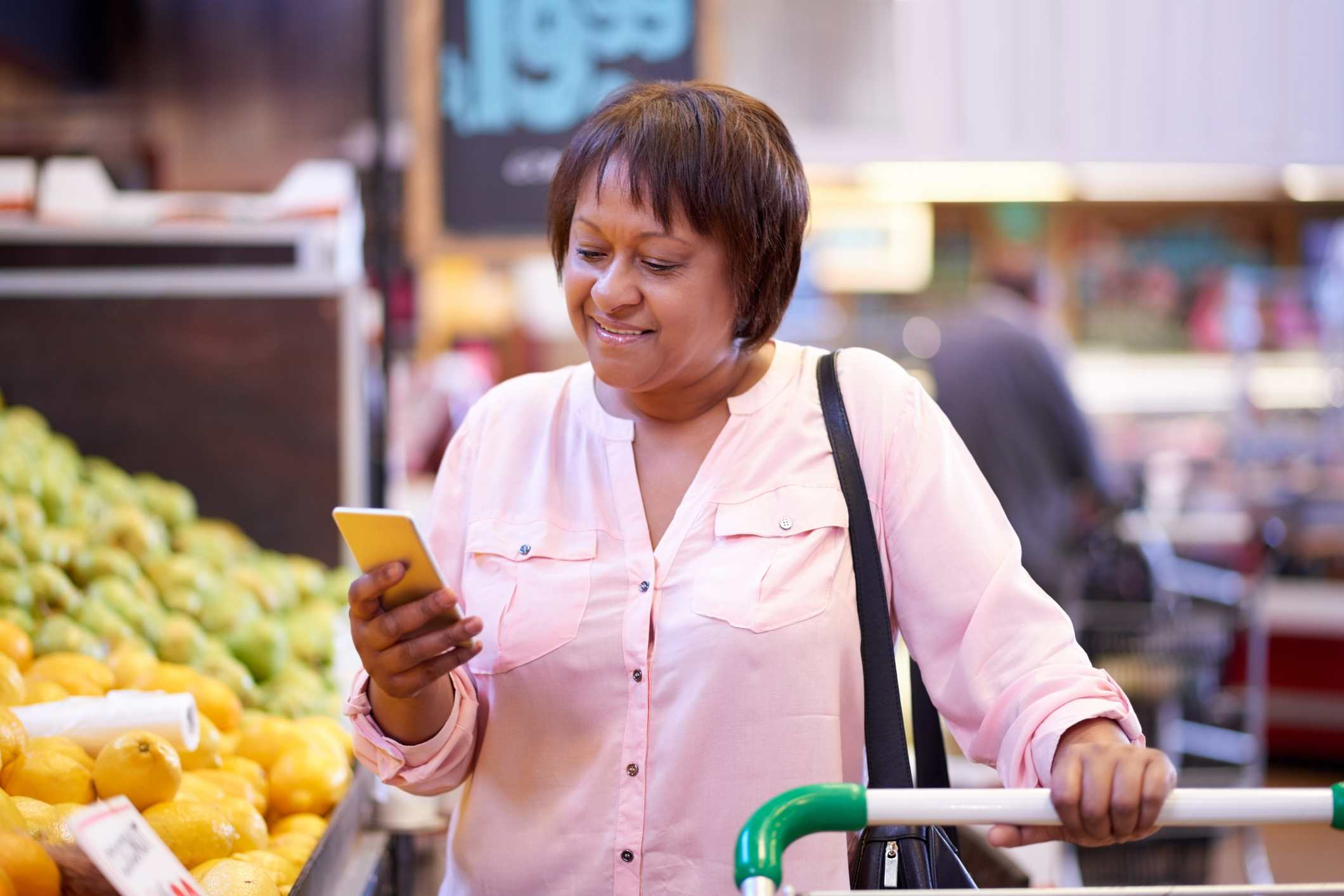 Woman shopping with grocery store app