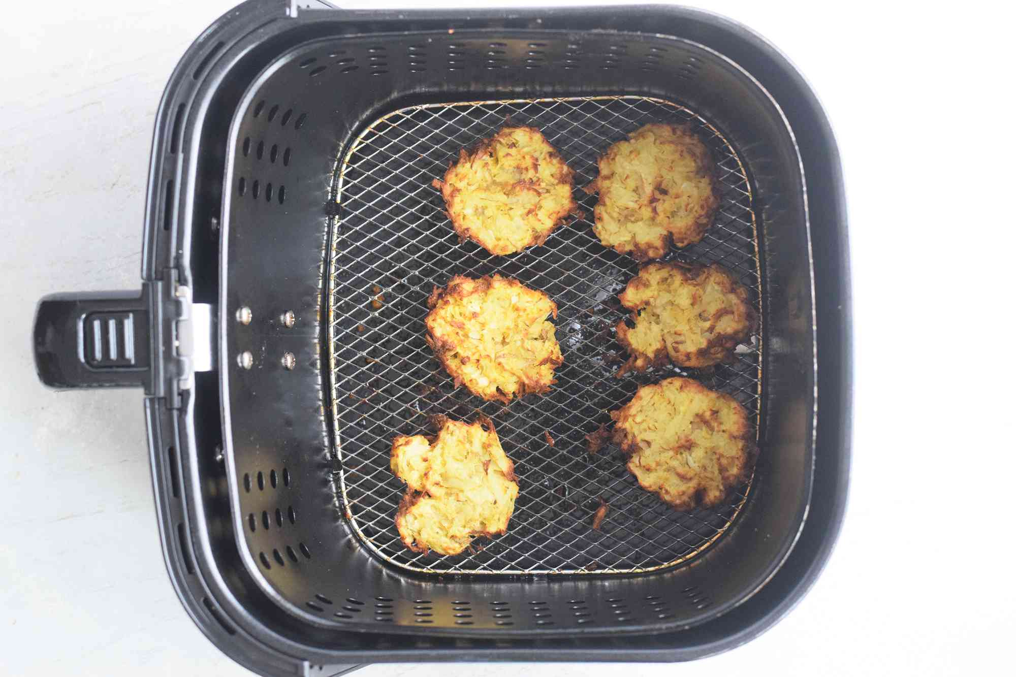 Cooking until both sides of latkes are golden brown and crisp