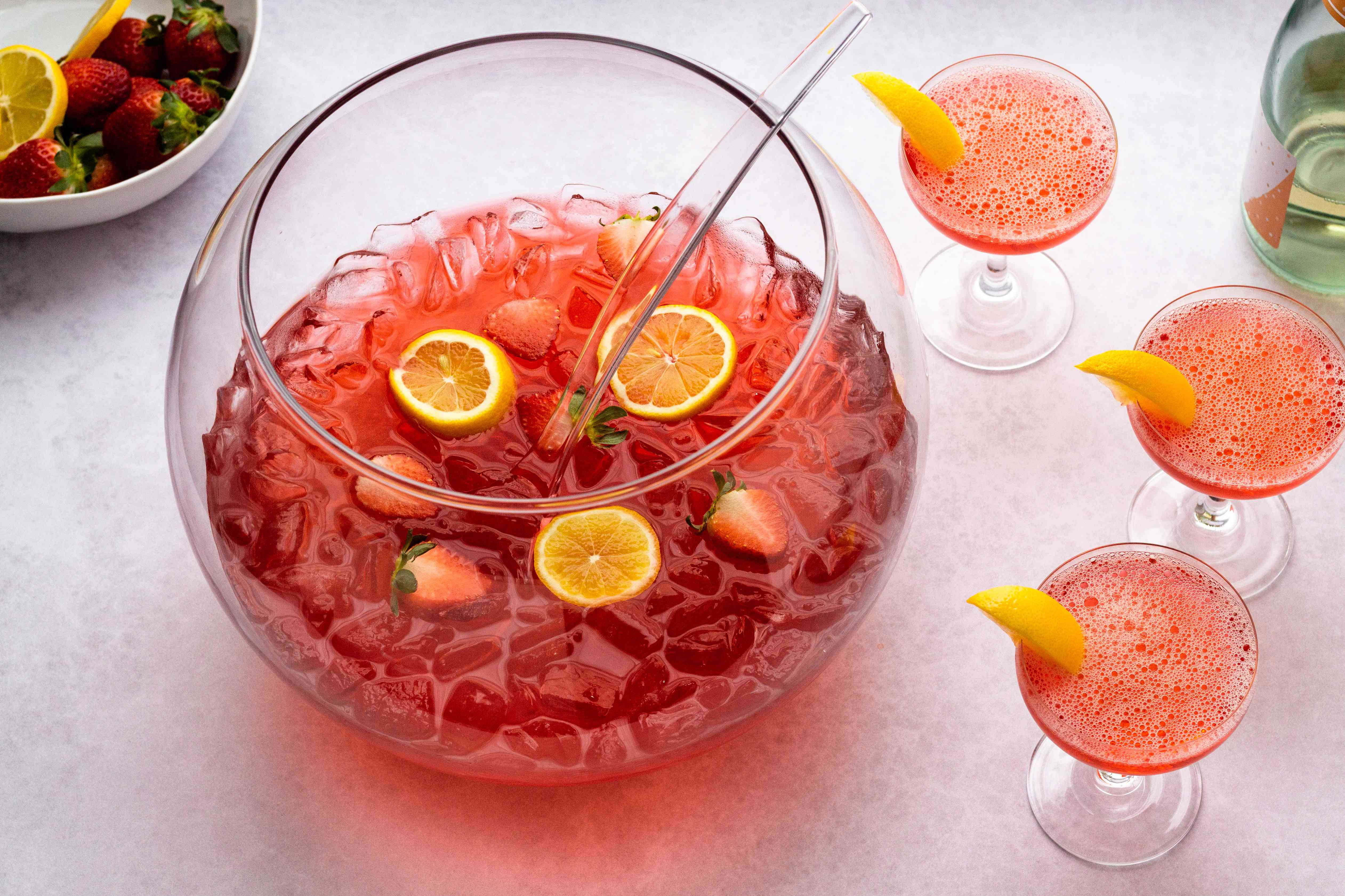 Jim Beam Fruit Punch, Garnish each glass with a strawberry or lemon twist on the rim