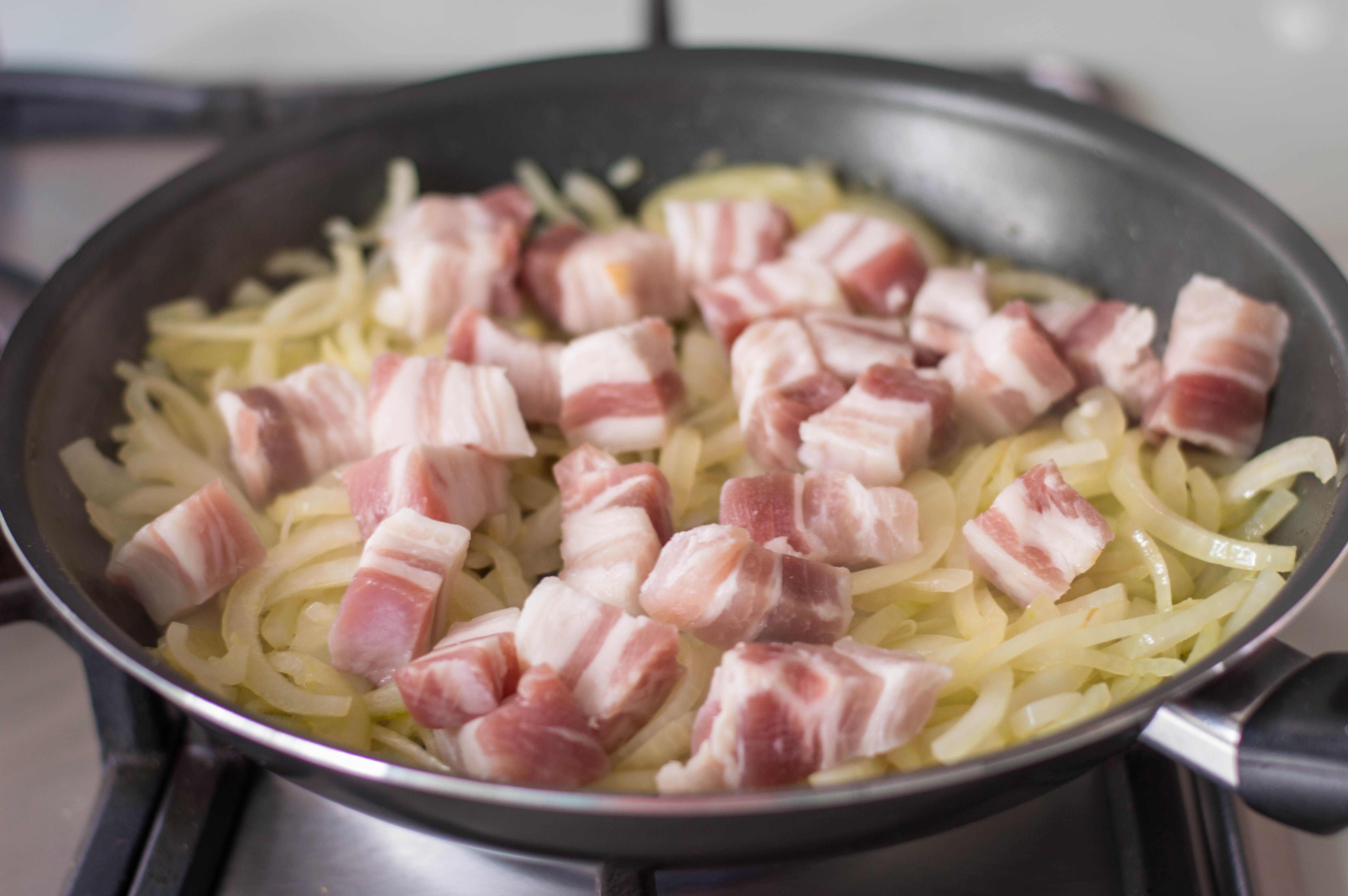 Add bacon to onions