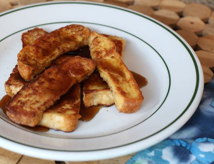Cinnamon French toast sticks served with syrup