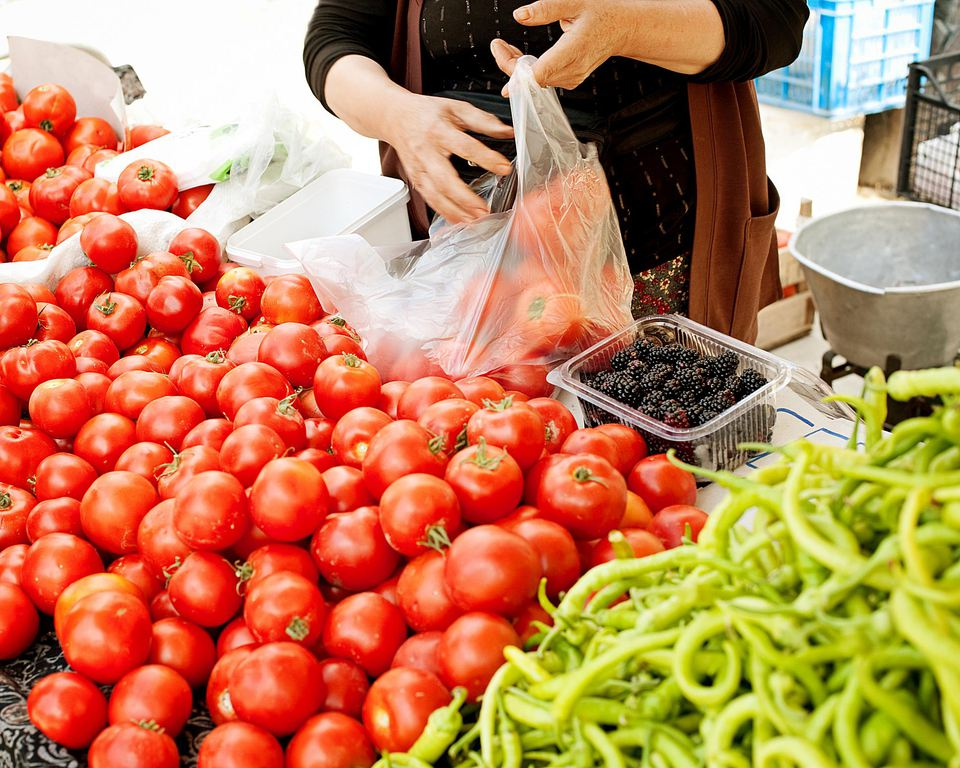 woman bagging vegetables
