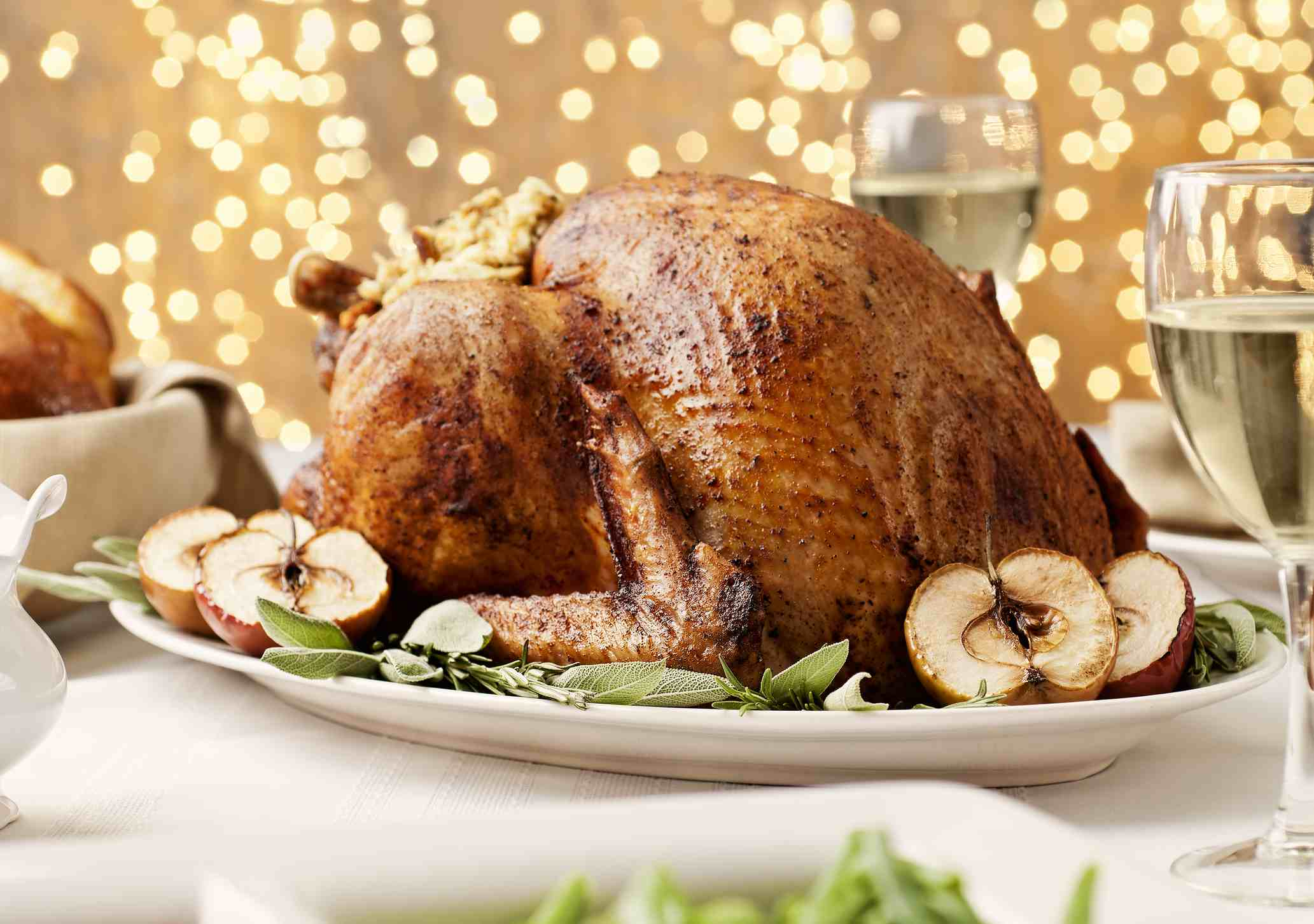 Oven-roasted Thanksgiving turkey on a platter with apples