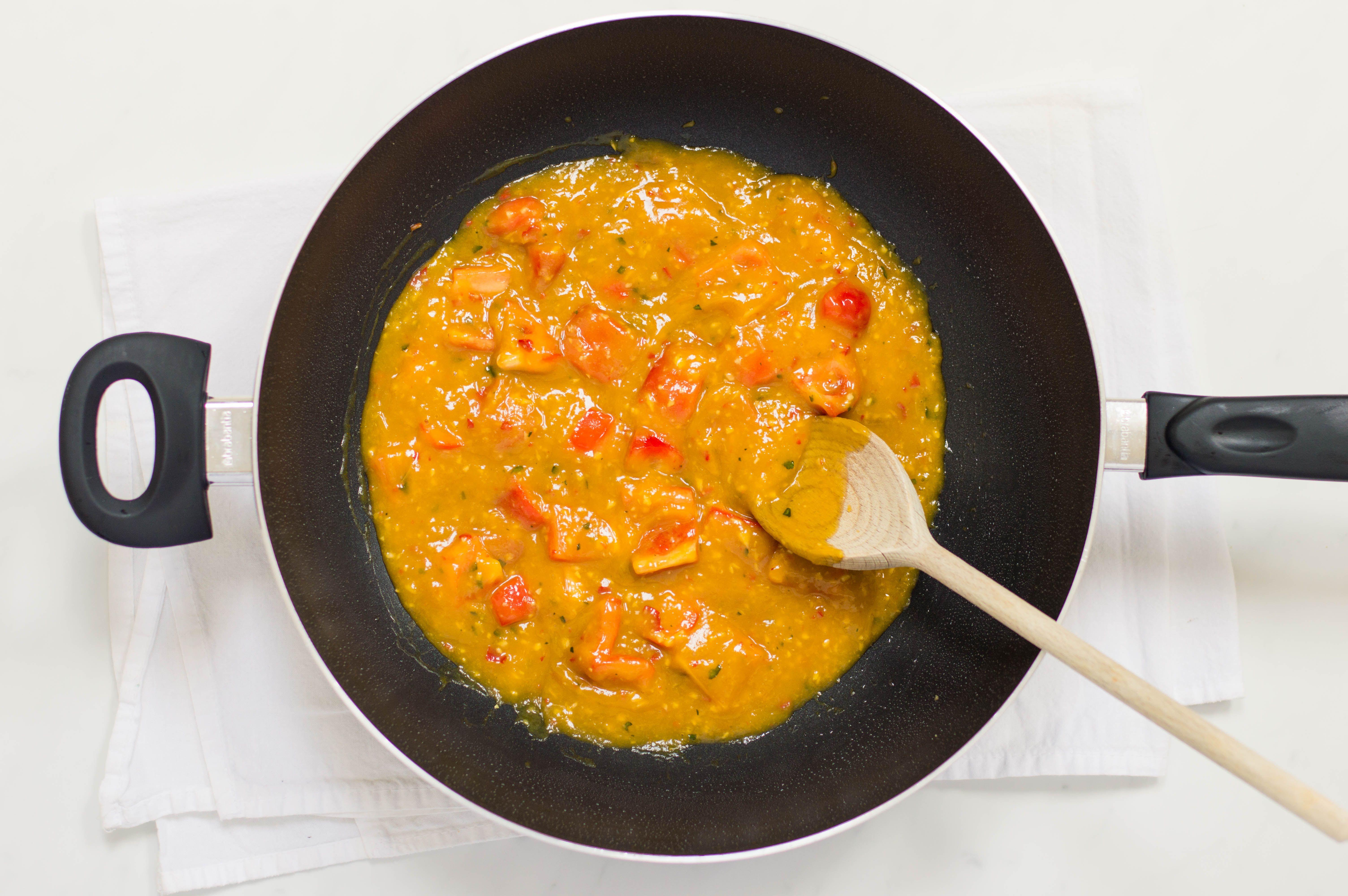 Thai mango chicken sauce simmering