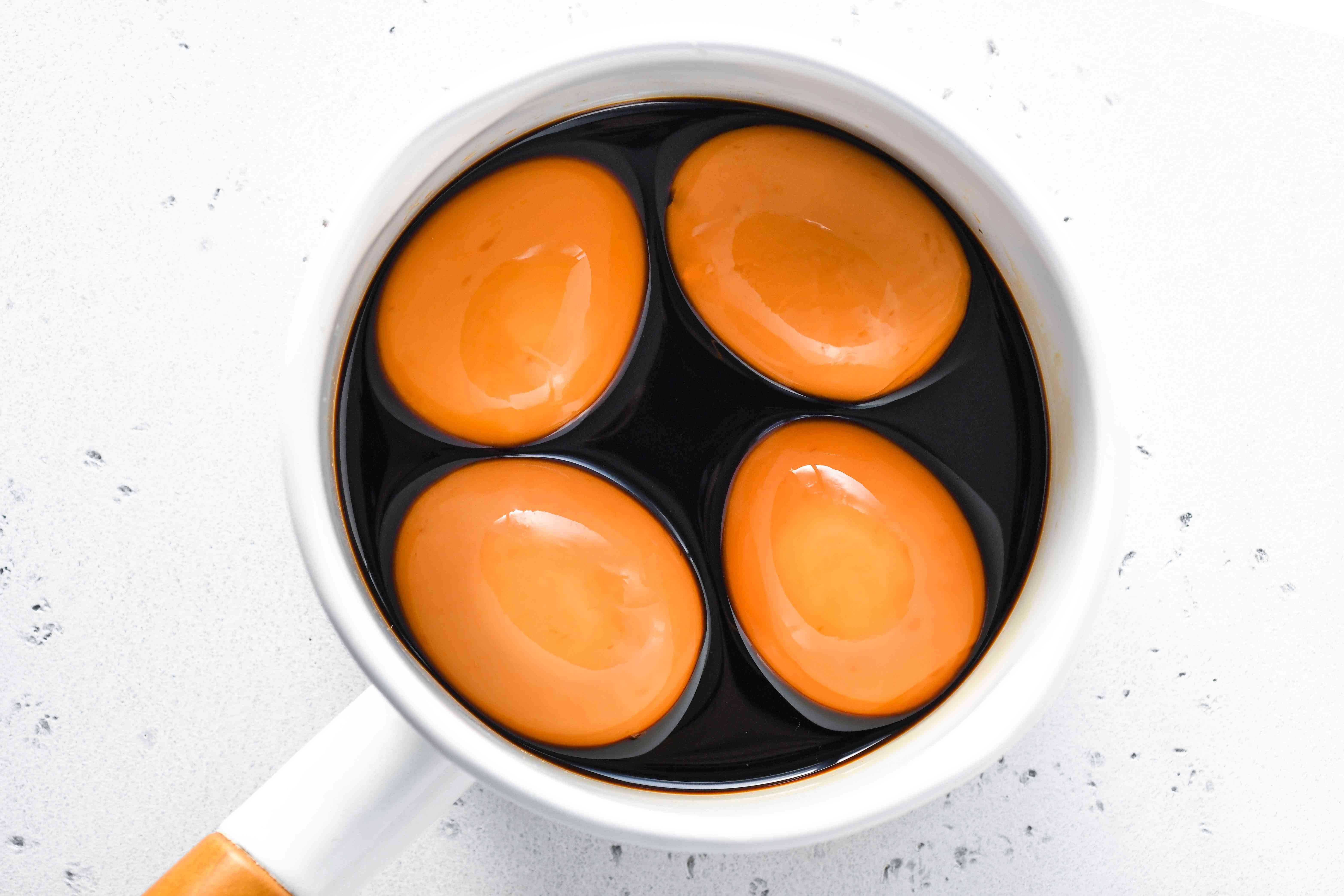 eggs in a pot of soy sauce