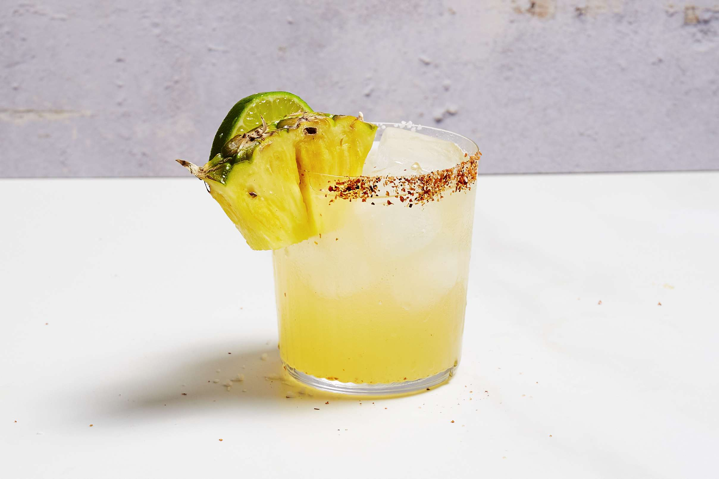 Pineapple Chili Margarita, garnished with pineapple and lime
