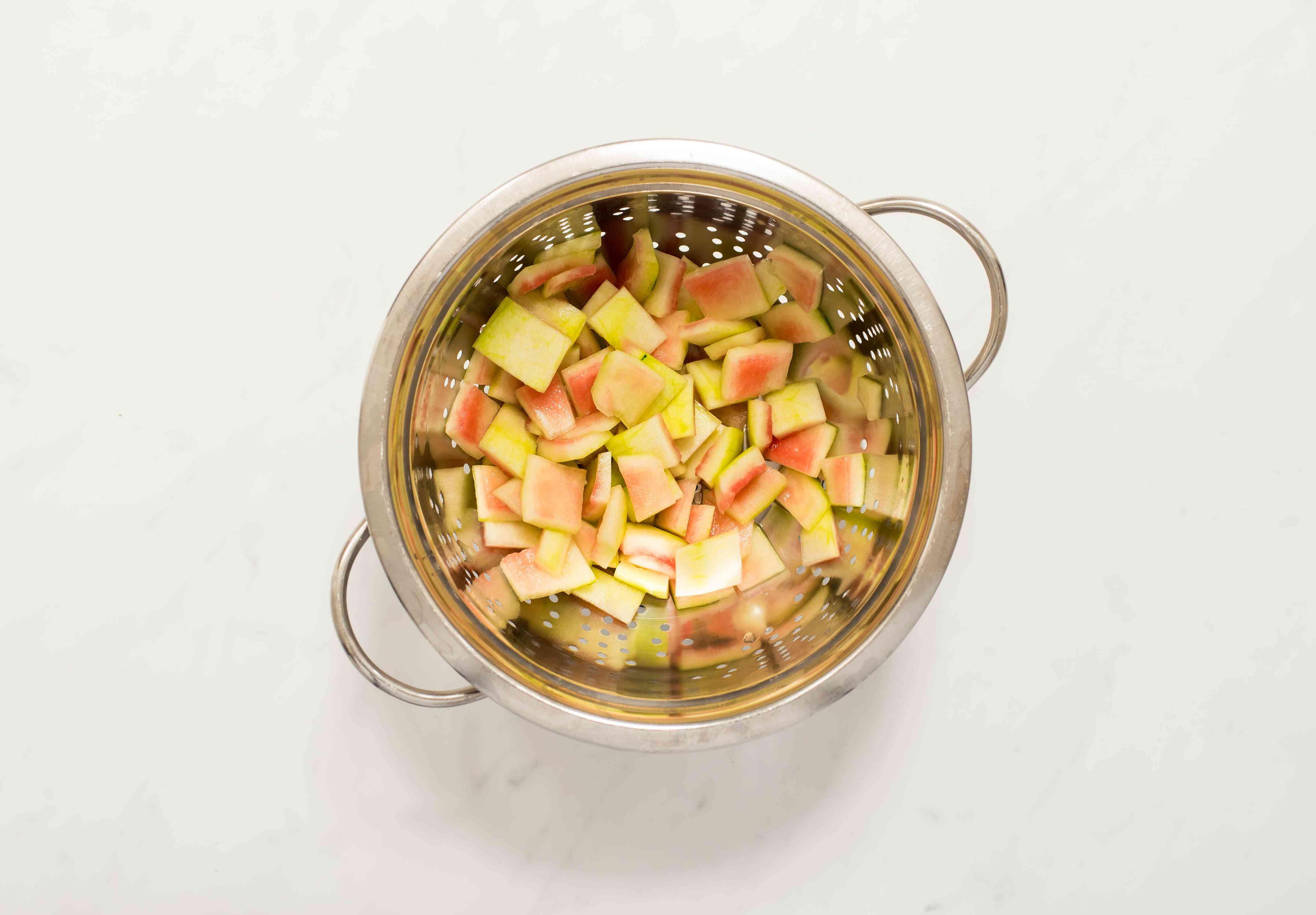 Watermelon rind in a colander