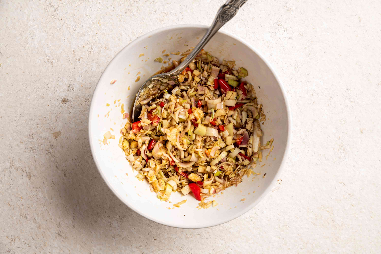 combine minced lemon grass, chili peppers, garlic, black pepper, salt, sugar, fish sauce, lemon juice and soy sauce