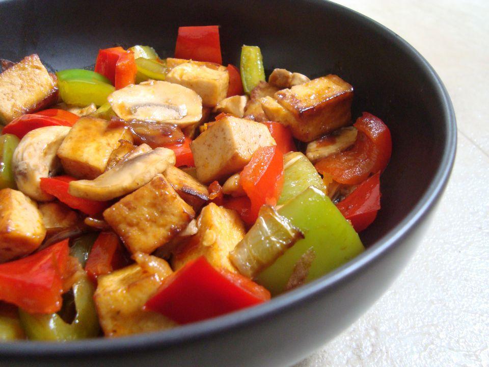 Vegan stir-fry with tofu, peppers, and mushrooms in hoisin sauce