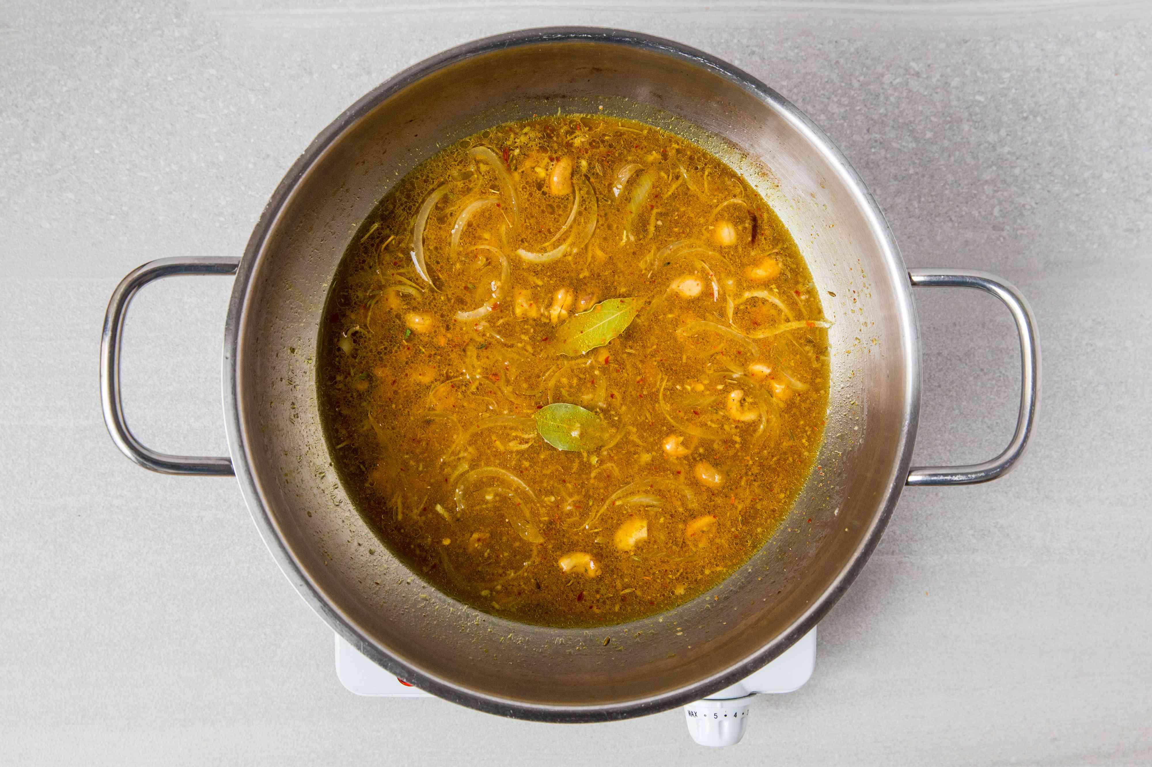 A pot of seasoned broth simmering