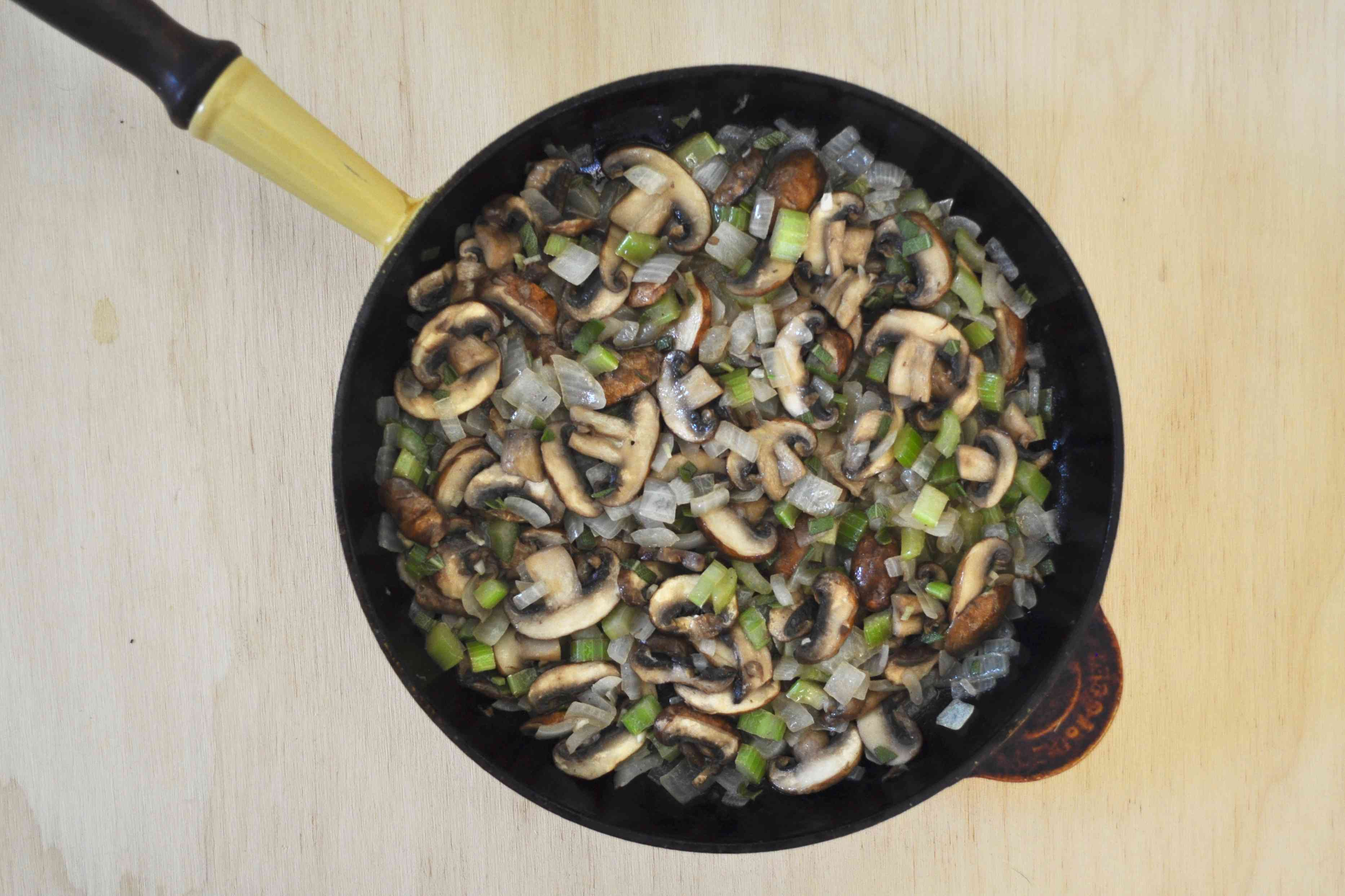 Saute onions, celery, and mushrooms for wild rice stuffing