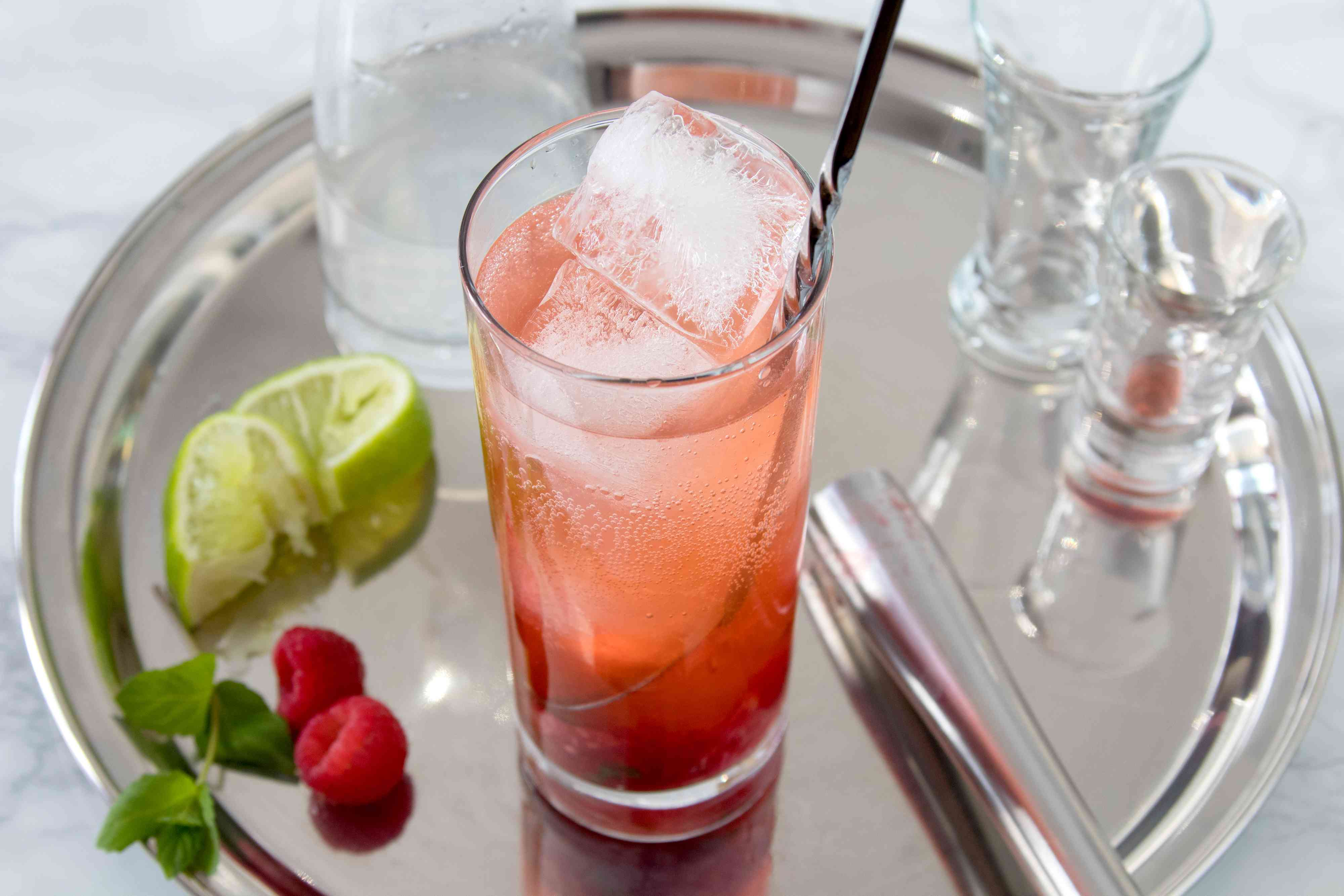 Ginger ale added to the raspberry mojito and mixed