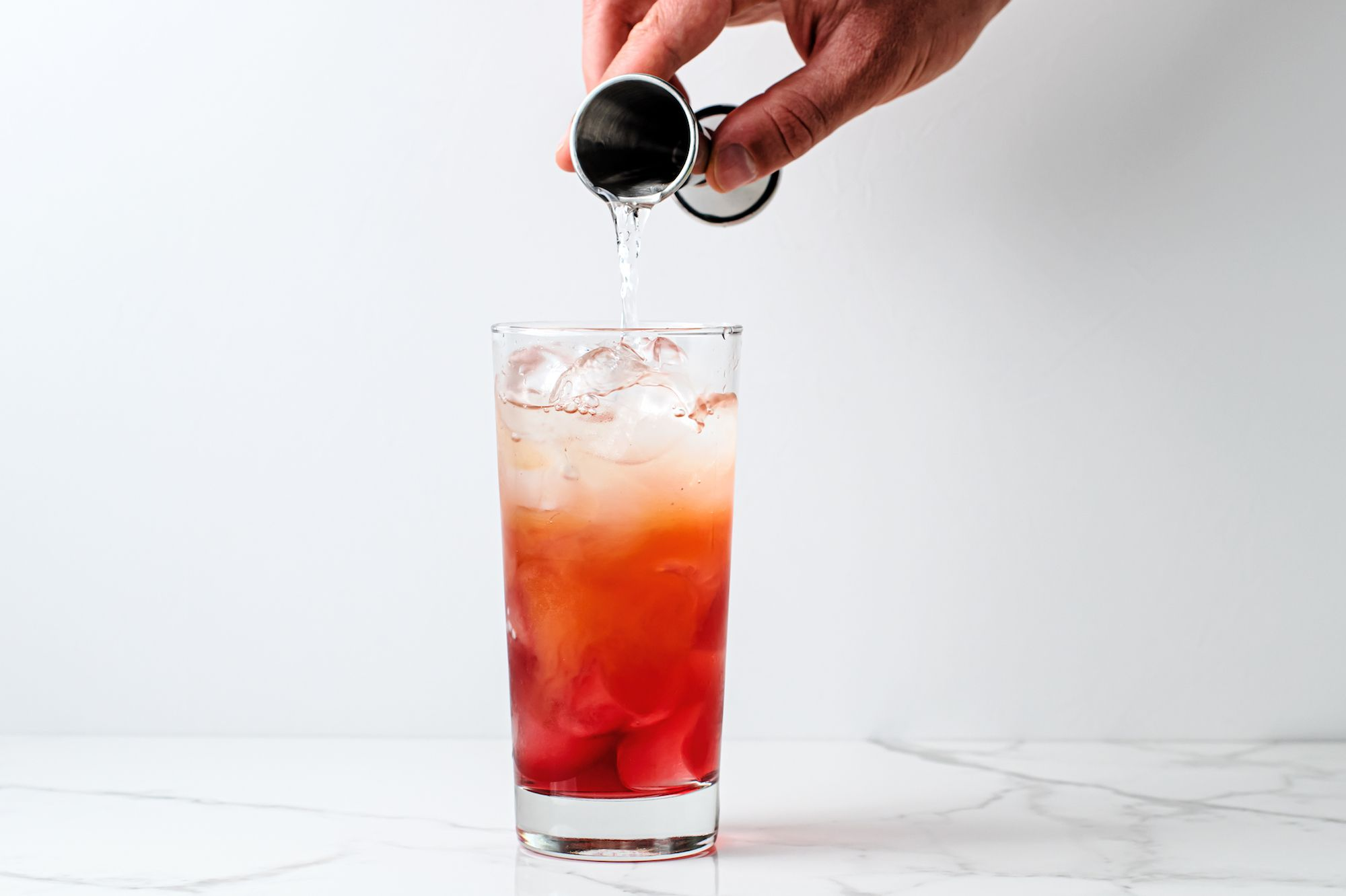 Madras cocktail ingredients poured into a glass