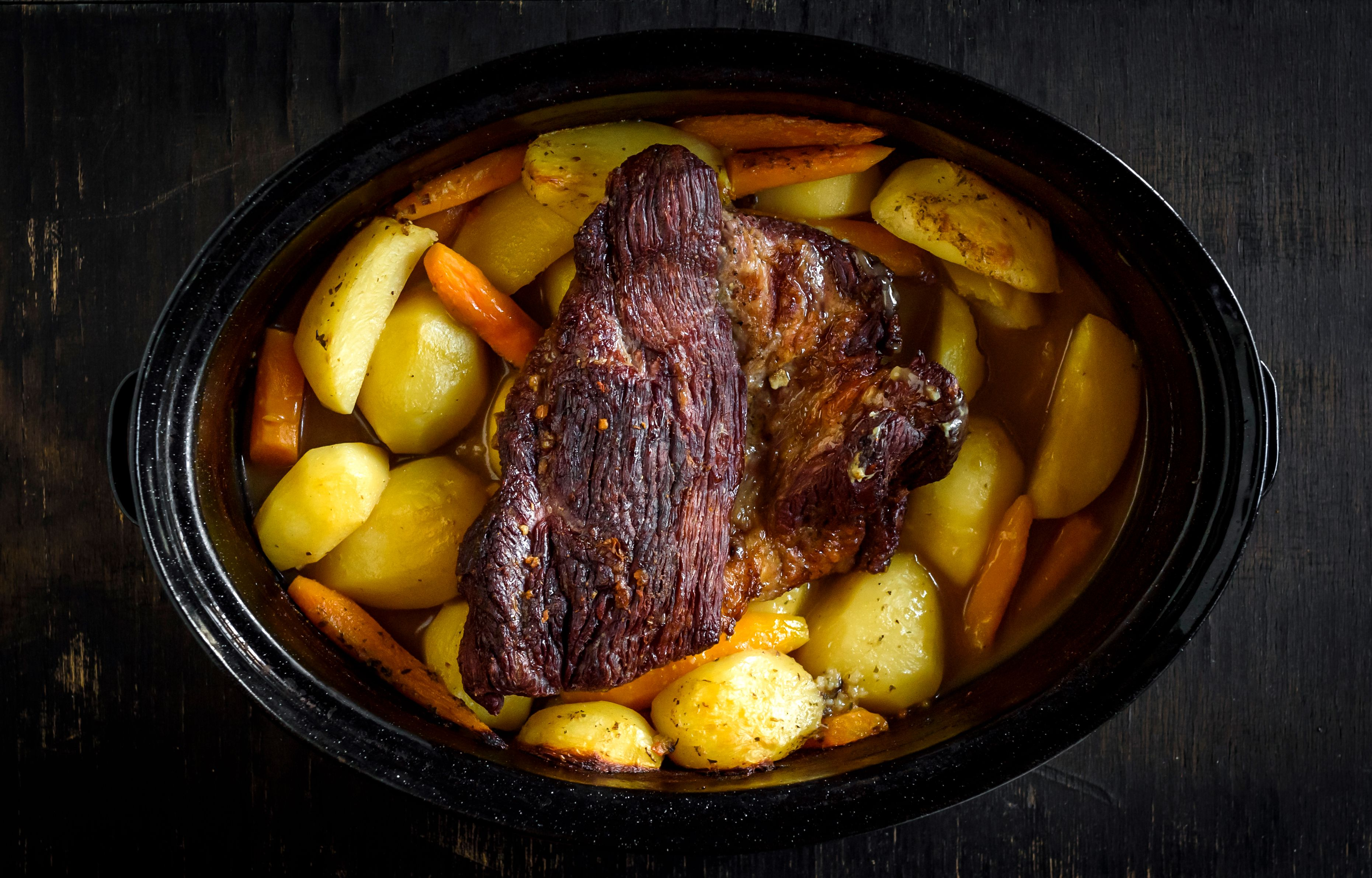 Pot roast and vegetables in a crock pot