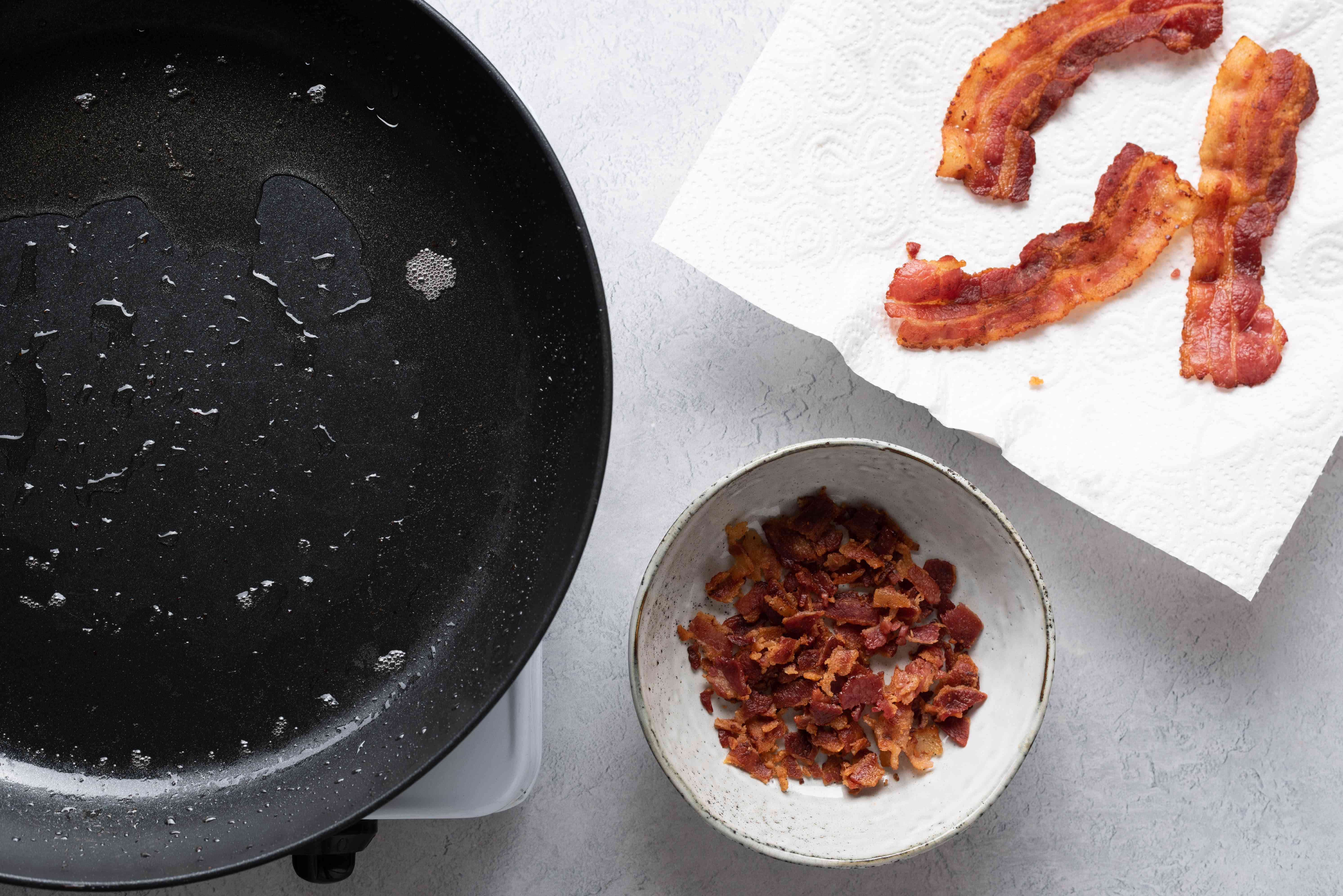fried bacon in a bowl and on paper towels