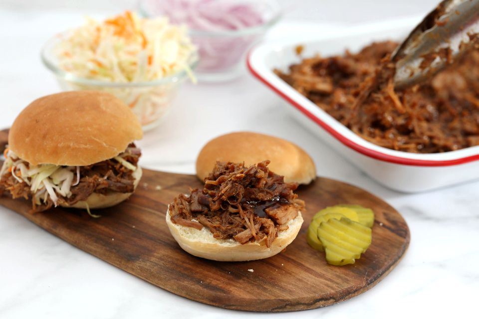 "Instant Pot pulled pork on buns with all the ""fixins."""