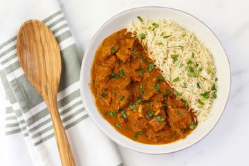Instant Pot butter chicken in a dish with rice.