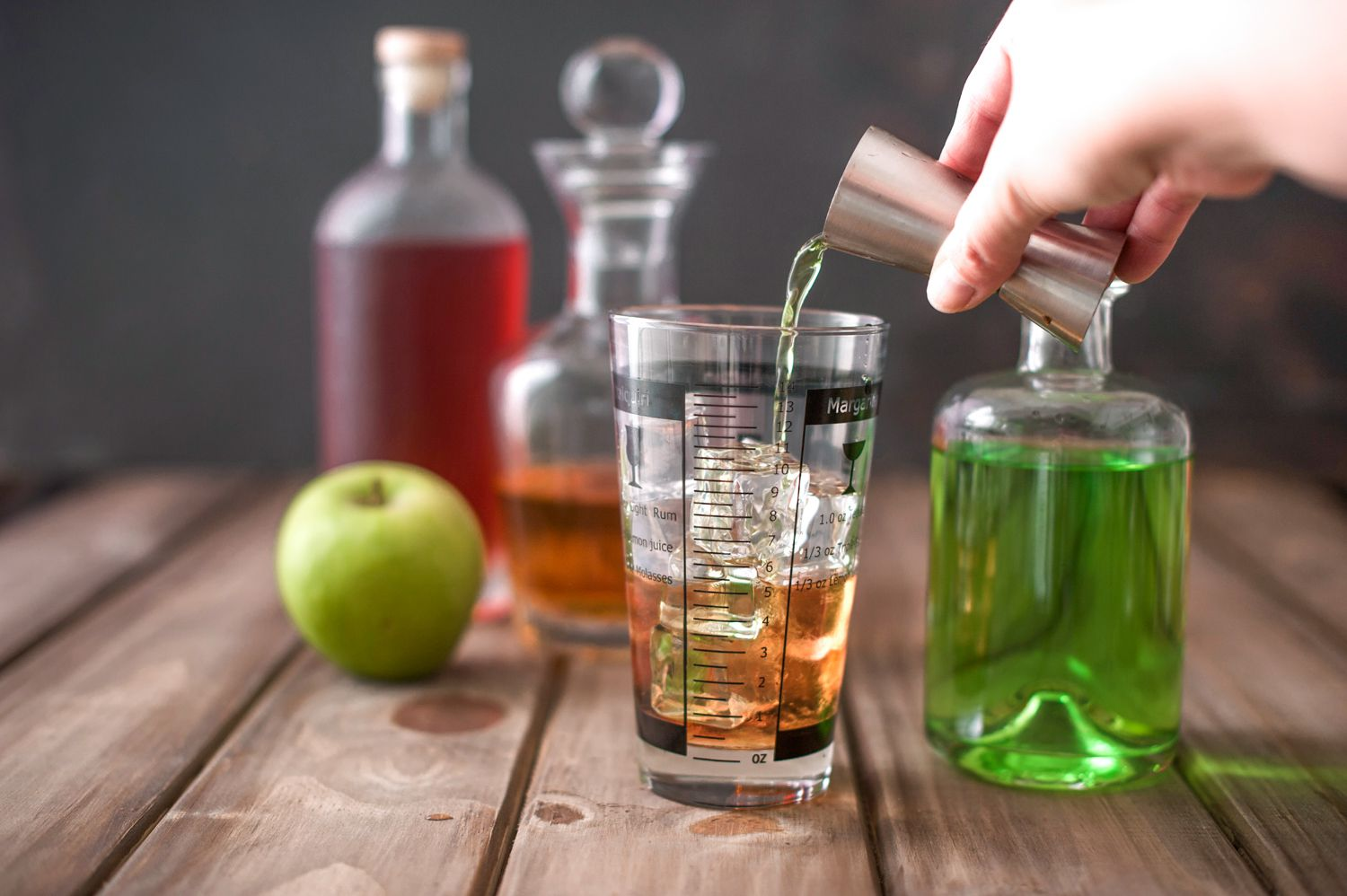 Pour ingredients into a cocktail mixer with ice