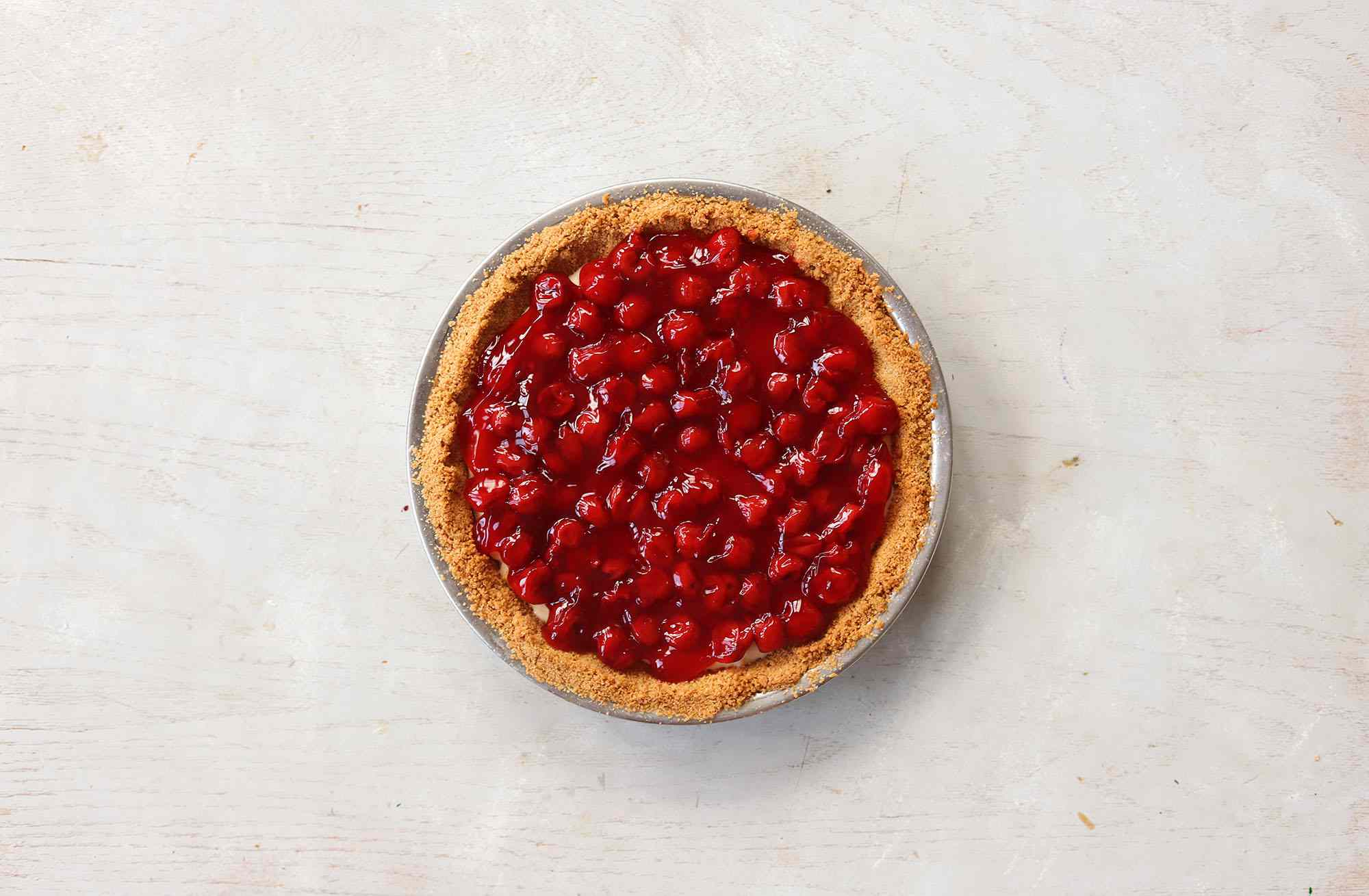 Cherry pie filling on top of cream cheese pie
