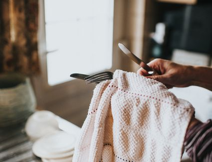 Drying utensils with a towel