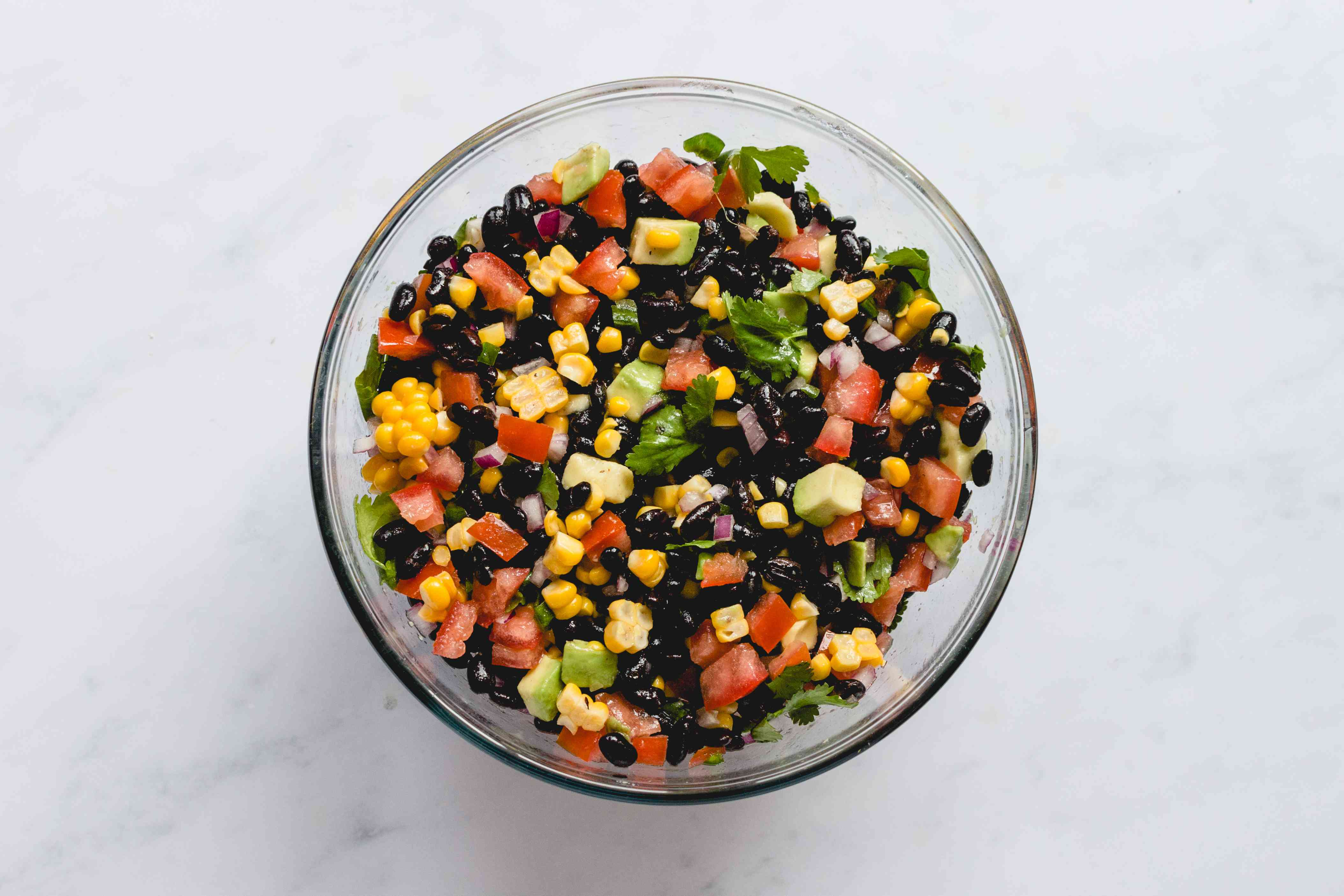black bean salad ingredients combined in a bowl