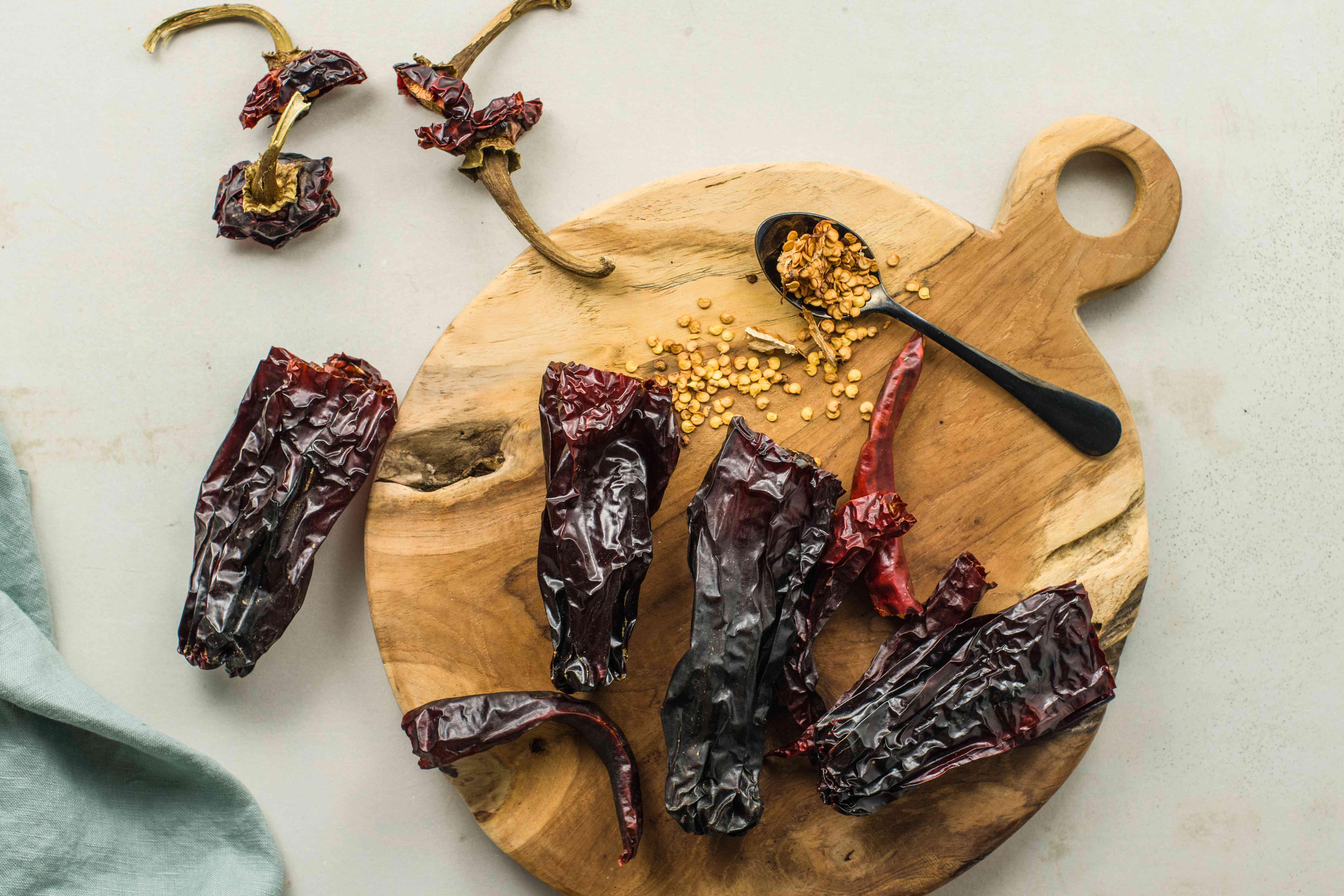 Cut tops off chiles