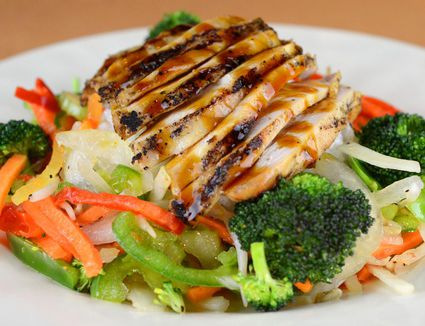Chicken teriyaki served with broccoli florets and sliced bell pepper