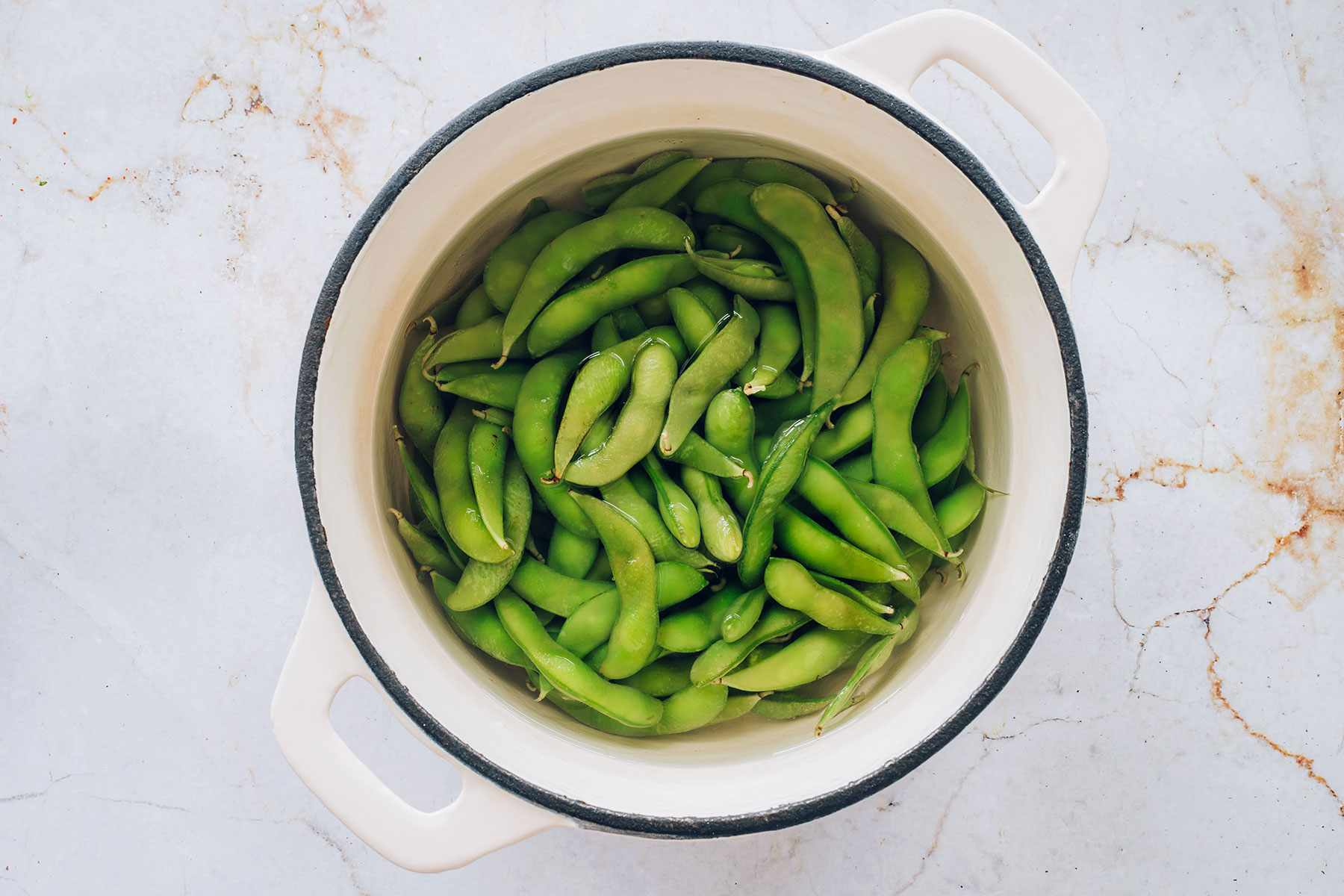 edamame in a pot of water