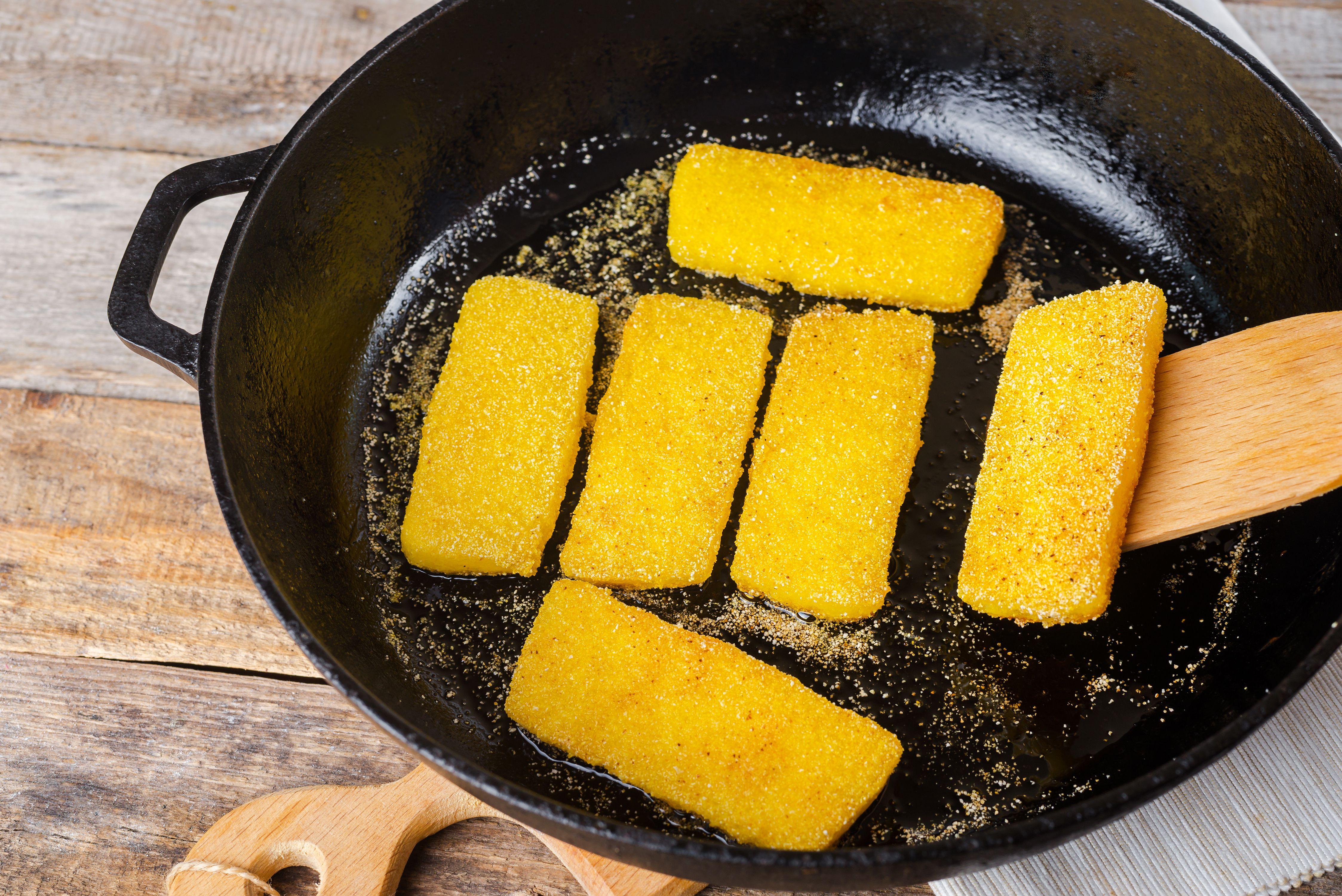 Flip cornmeal slices in the skillet