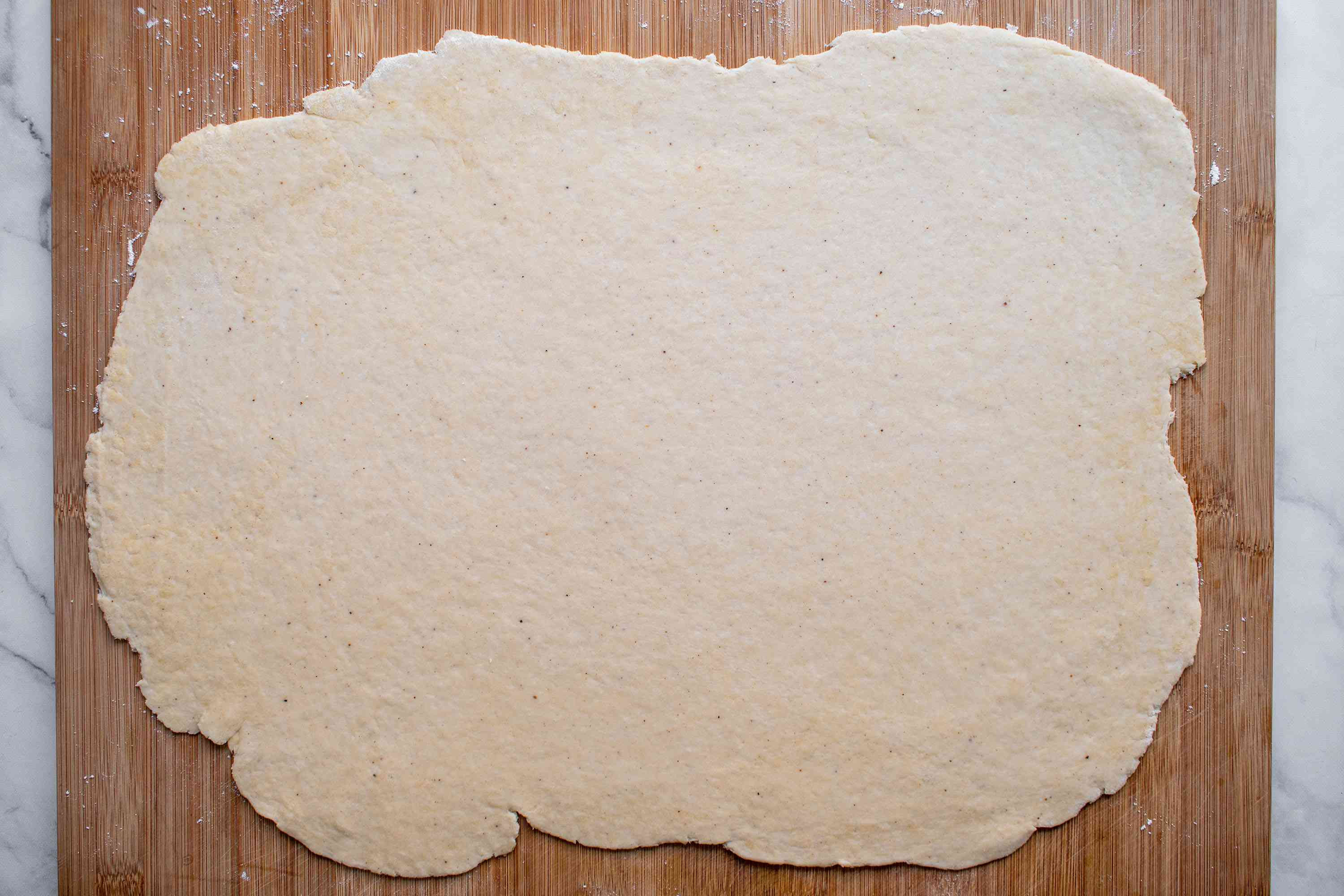 Roll out the dough on a lightly floured surface