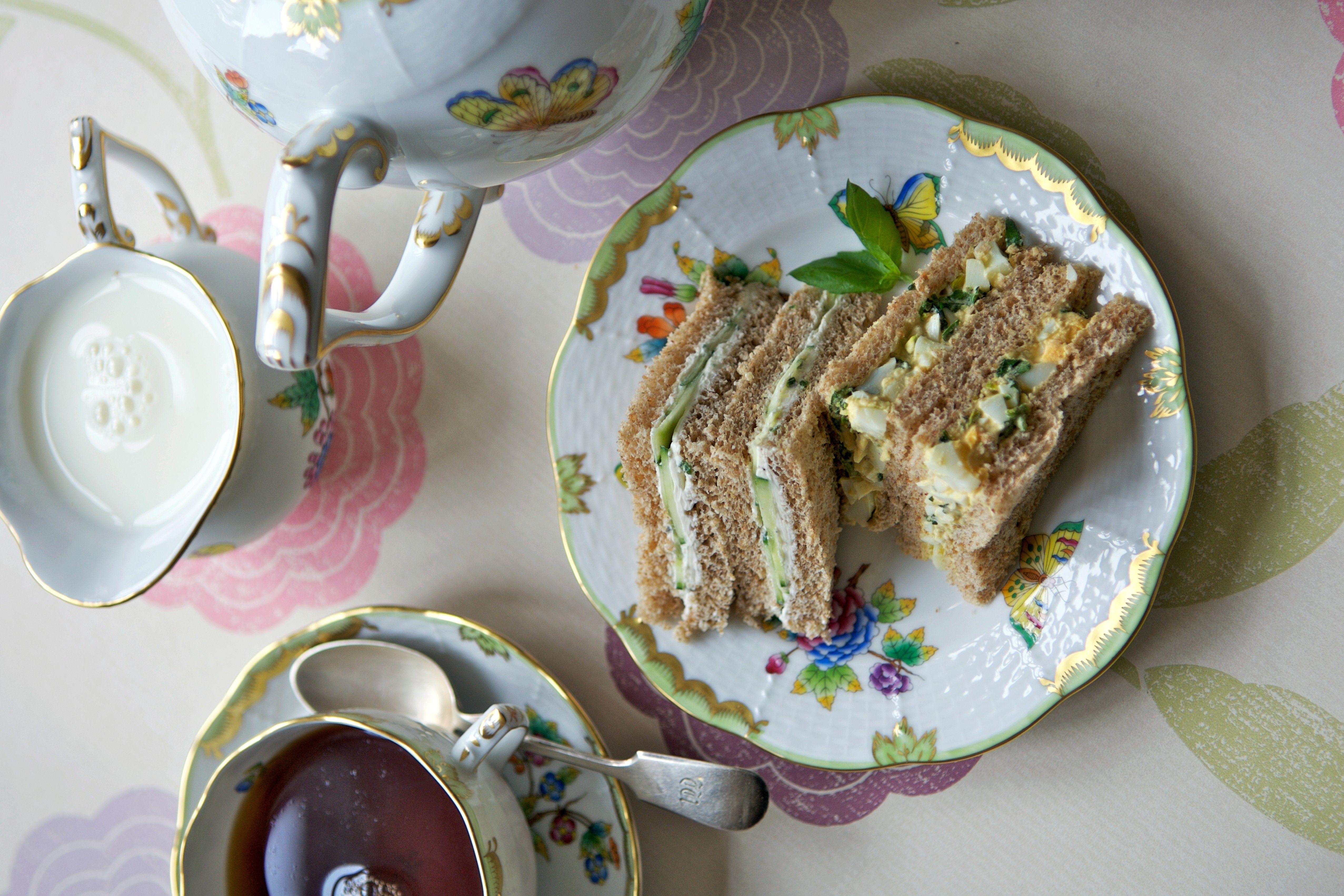 Veggie cream cheese finger sandwhiches served with tea