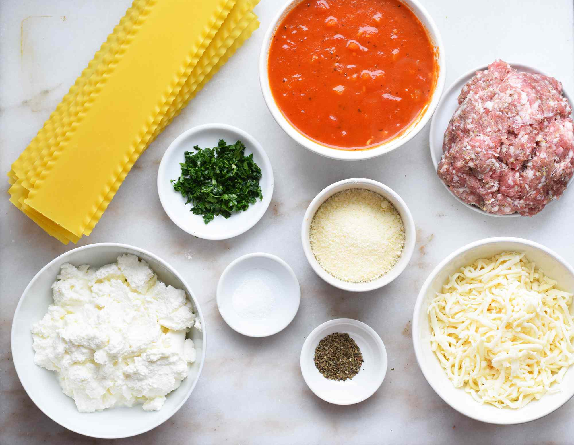 ingredients for skillet lasagna on a marble board