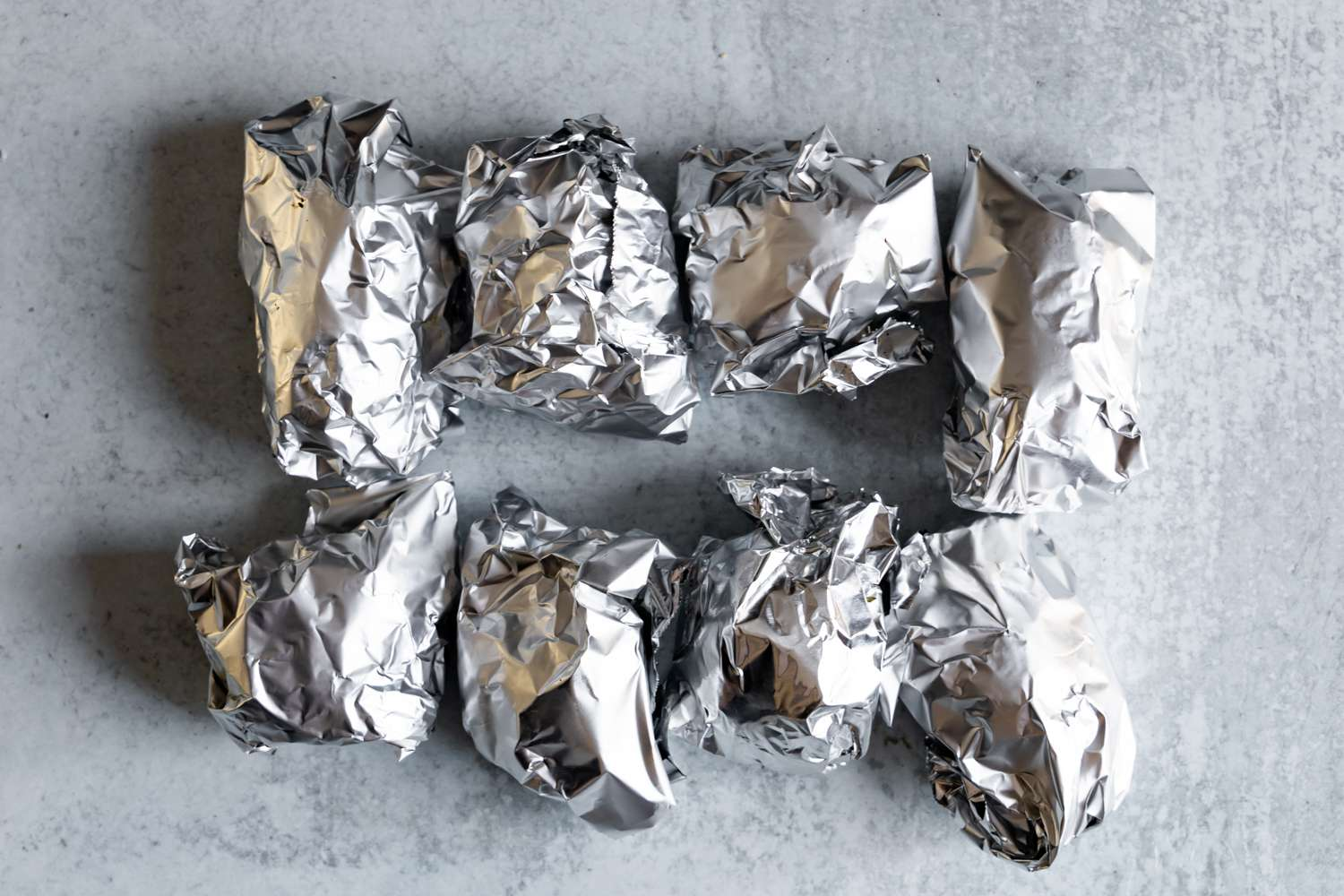 Potatoes wrapped with aluminum foil