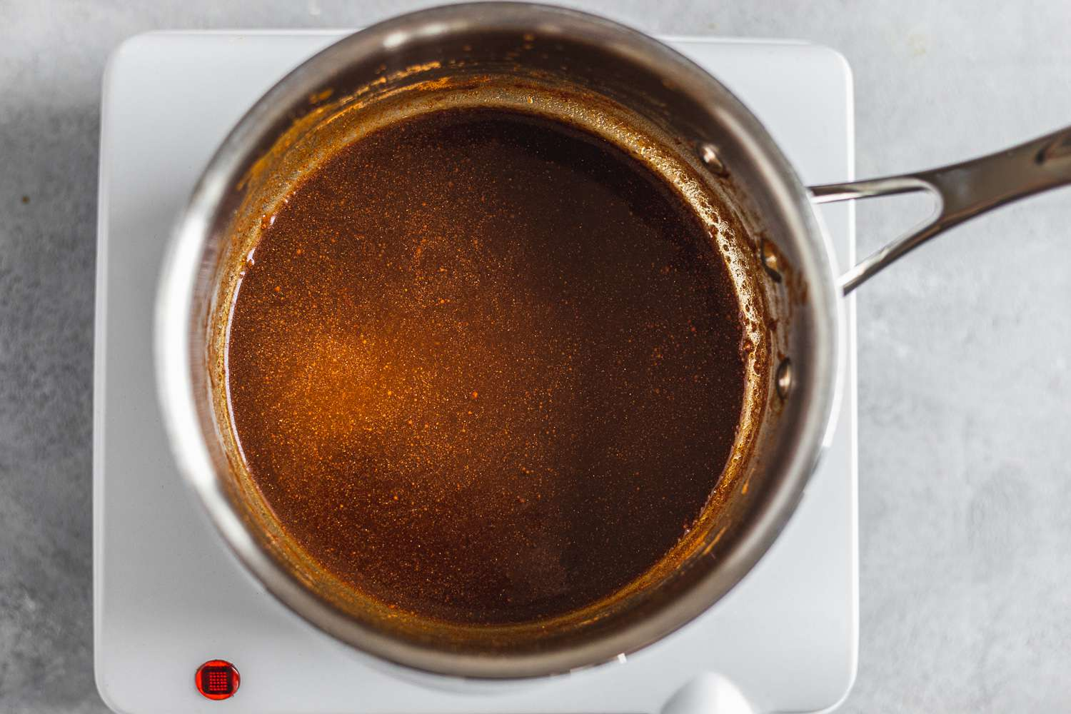 pumpkin puree, sugar and spices cooking together in a pot