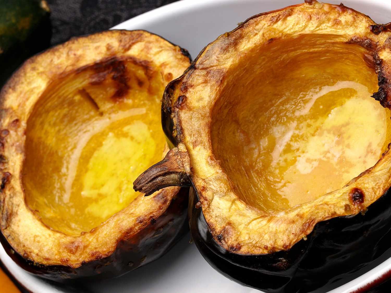 Two half of roasted acorn squash