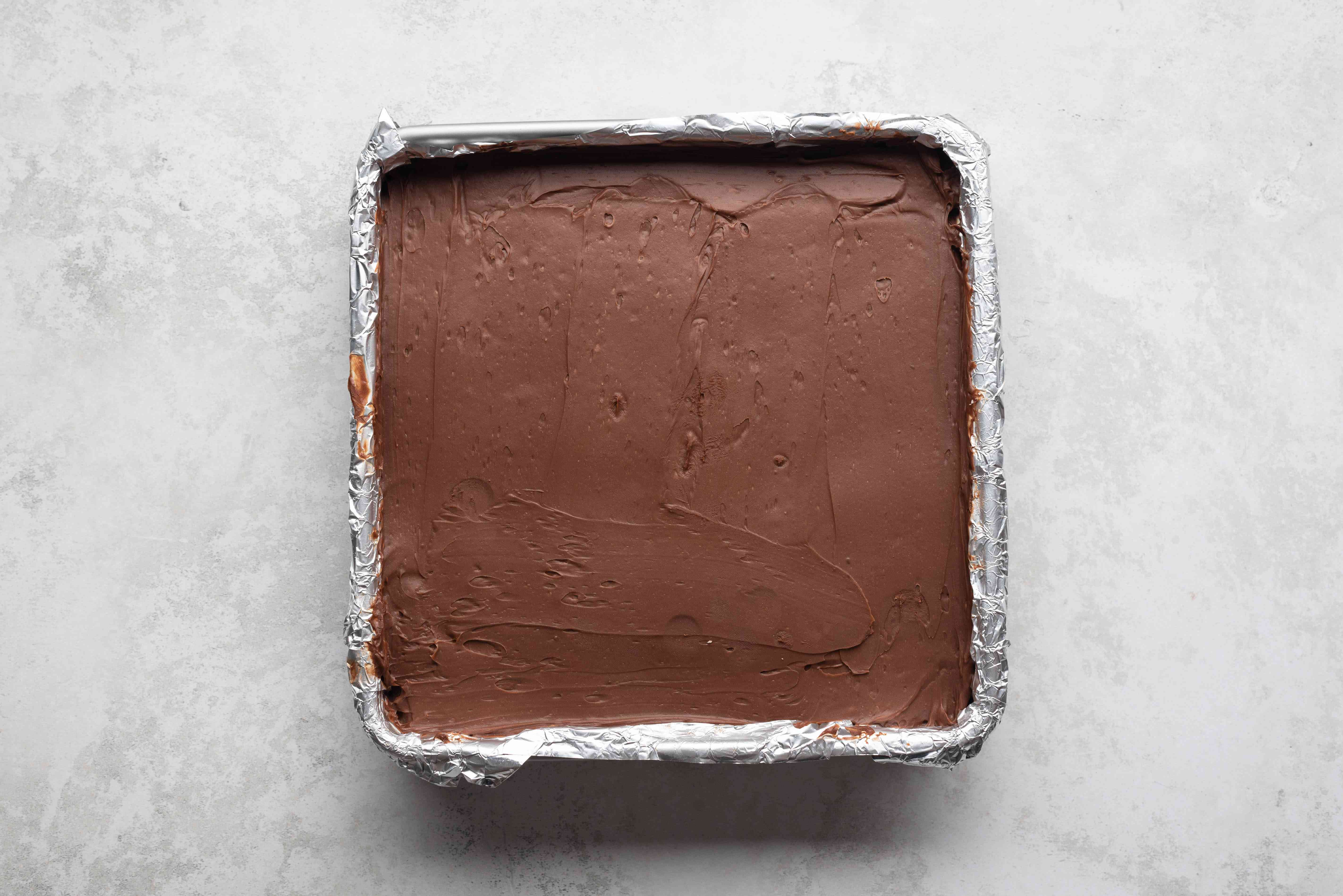 chilled chocolate mixture in a baking pan