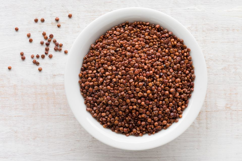 Close-Up Of Quinoa Seeds In Bowl On Table