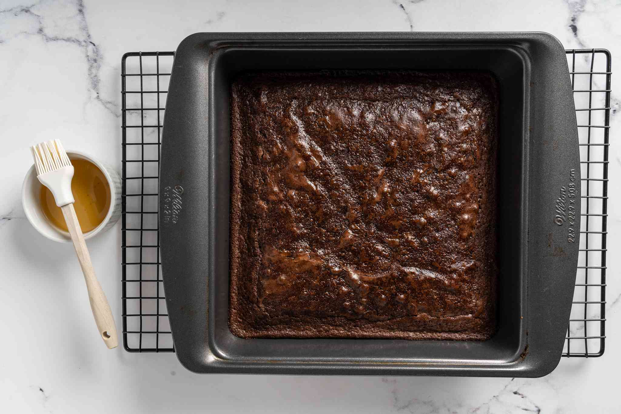 baked brownies in a baking pan on a cooling rack
