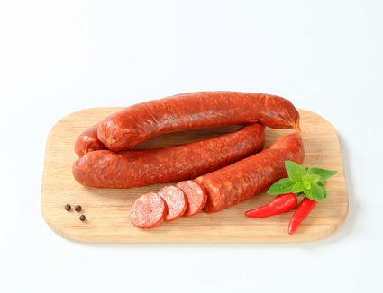 Red hot beef sausage on a cutting board