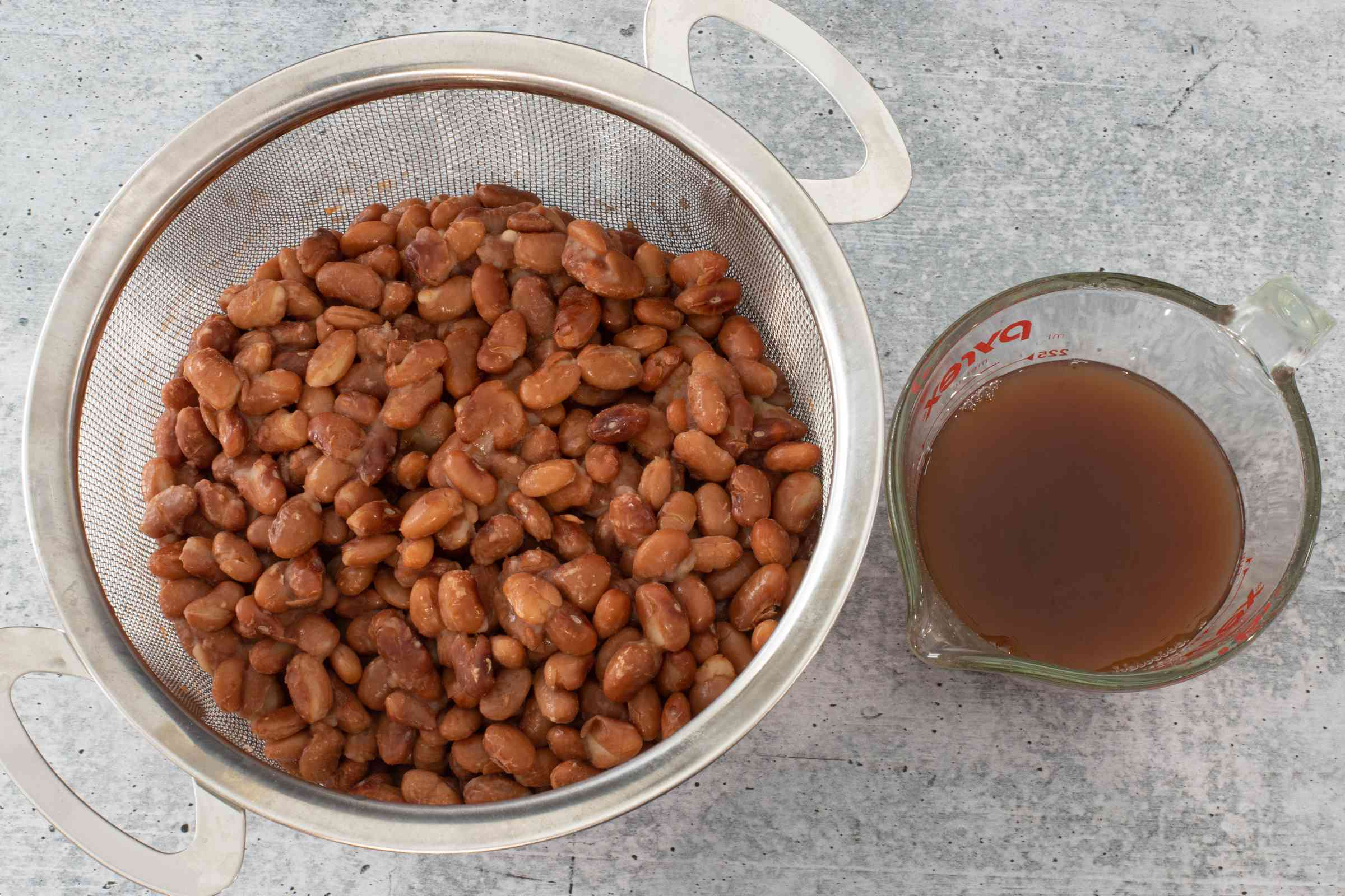 drain the beans and reserve 1 cup of the liquid