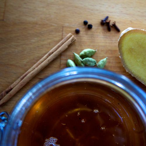 An image of Chai Simple Syrup and masala chai spices.